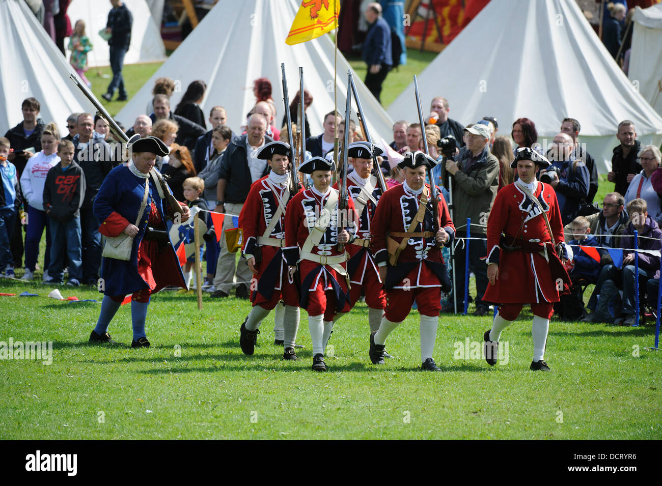 Redcoats march on the Jacobites during a re-enactment at Scotland's Festival of History at Chatelherault South - Stock Image