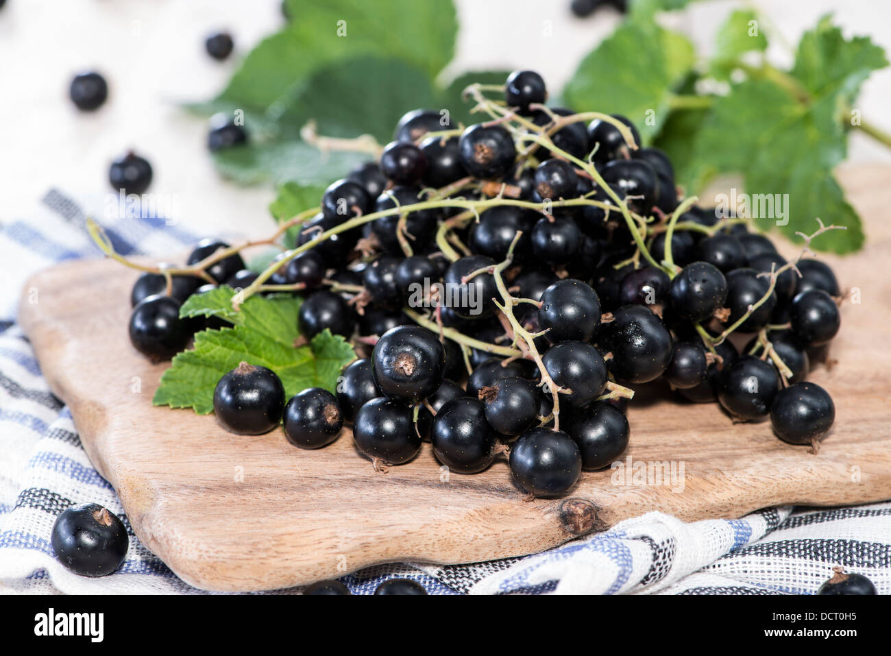 Heap of Black Currants on wooden background Stock Photo