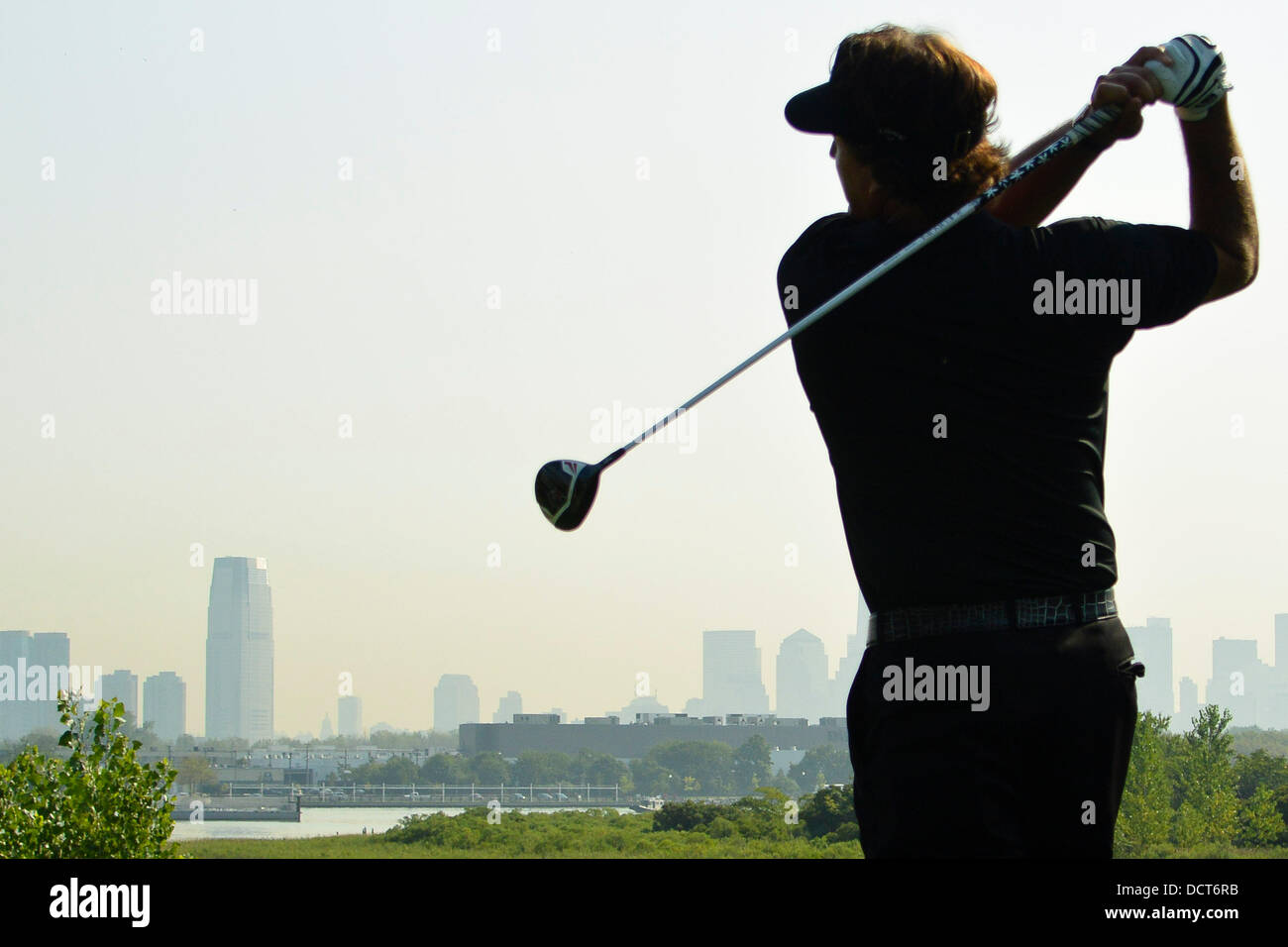 Jersey City, New Jersey, USA. 20th Aug, 2013. August 21, 2013: Phil Mickelson (USA) follows through on the 18th - Stock Image