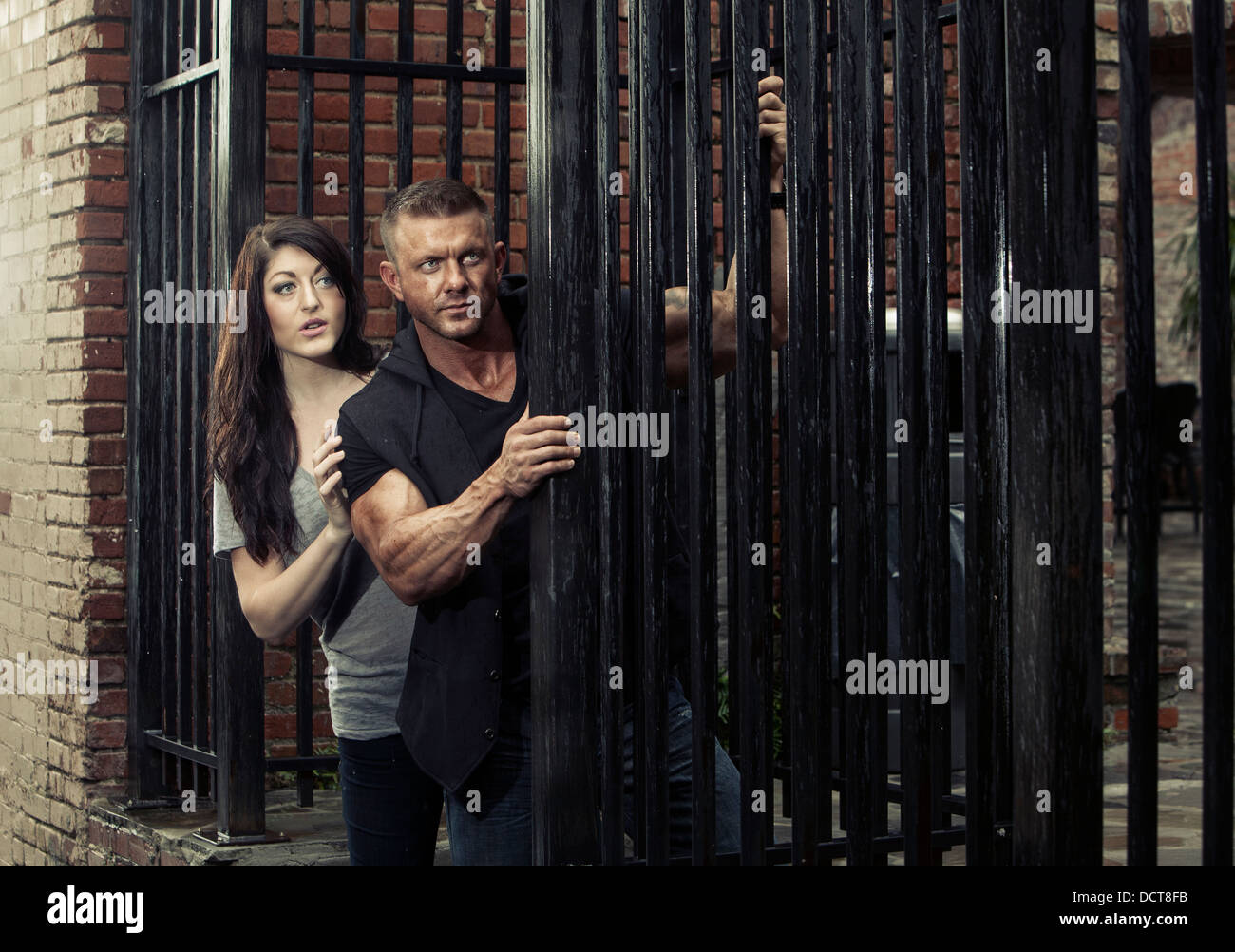 Man and woman in urban setting with a spy movie theme - Stock Image