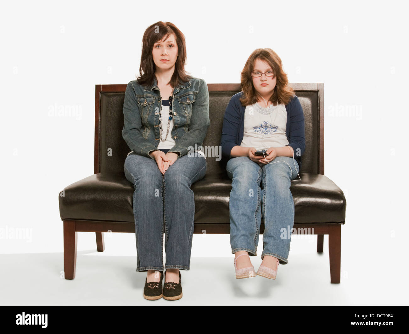 Mother And Daughter Ignoring Each Other; Edmonton, Alberta, Canada - Stock Image