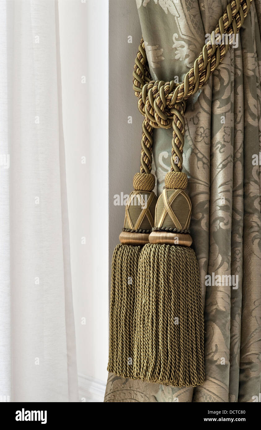 A Curtain Tie Back With Heavy Embroidered Tassels Stock