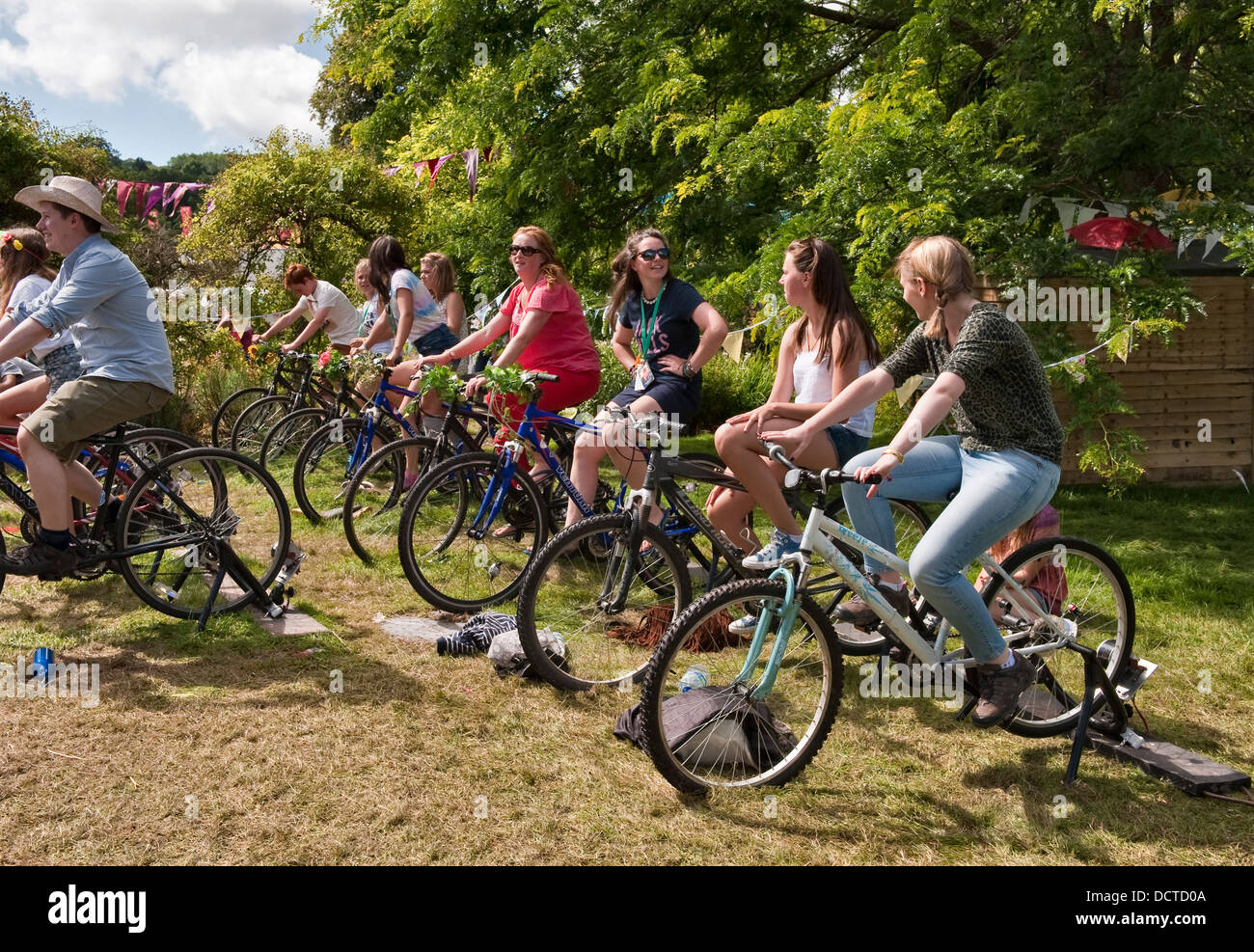 Green Man festival 2013, Glanusk, Wales. Festival goers using bicycle-powered generators to recharge mobiles - Stock Image