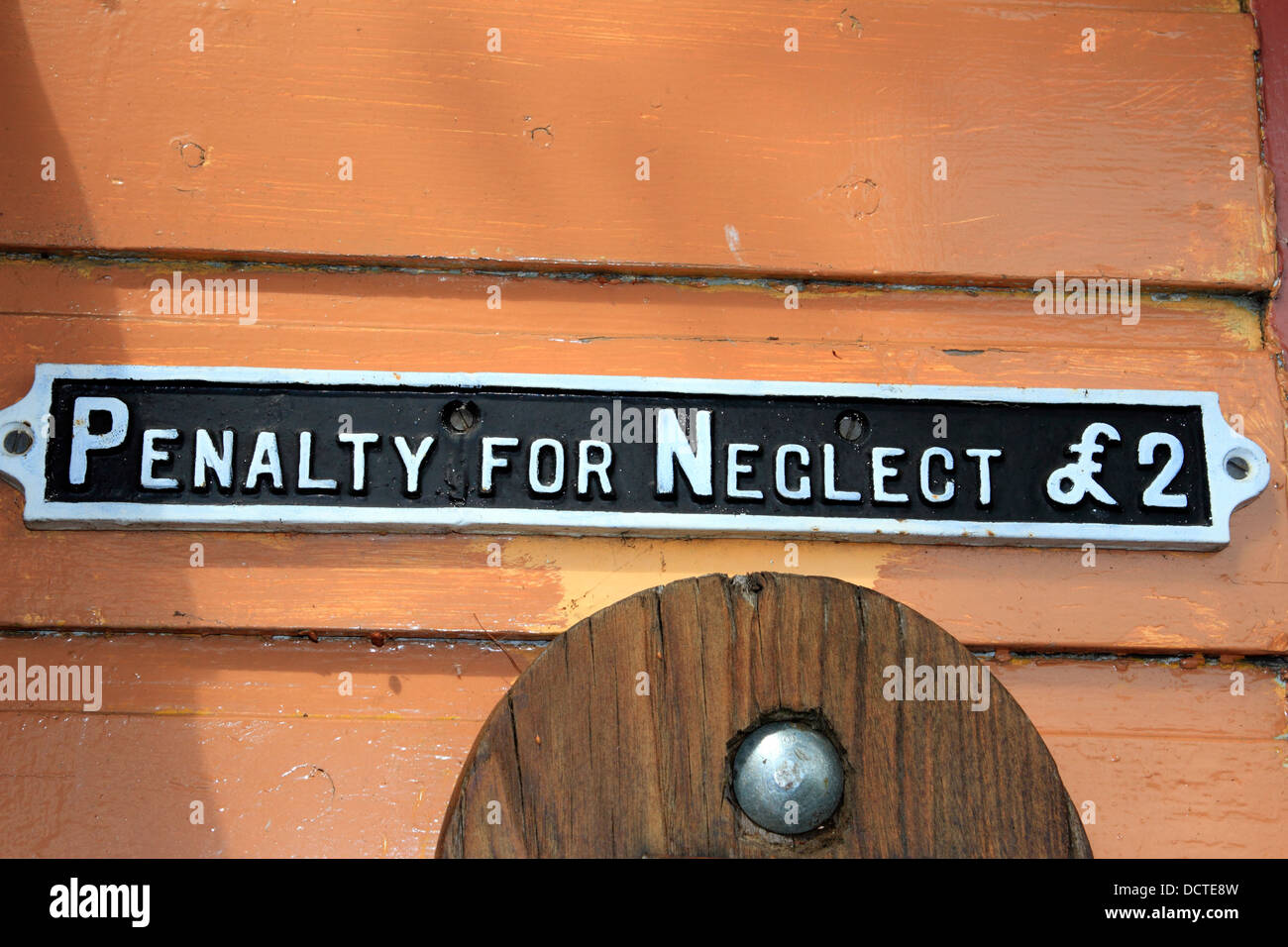 Penalty for neglect old railway sign - Stock Image