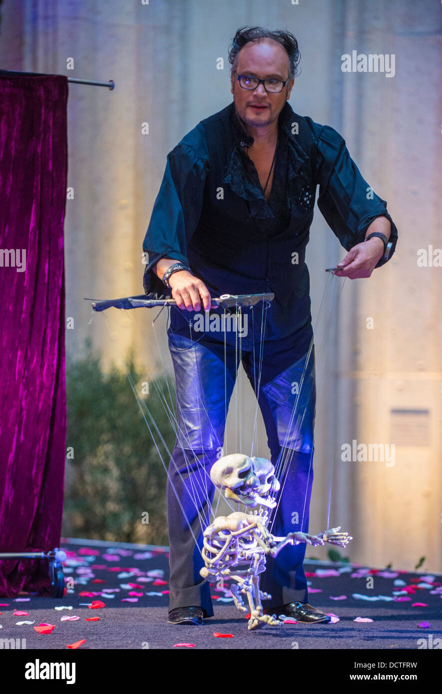 Puppeteer Perform at the Carnival experience festival in the Venetian Hotel in Las Vegas - Stock Image