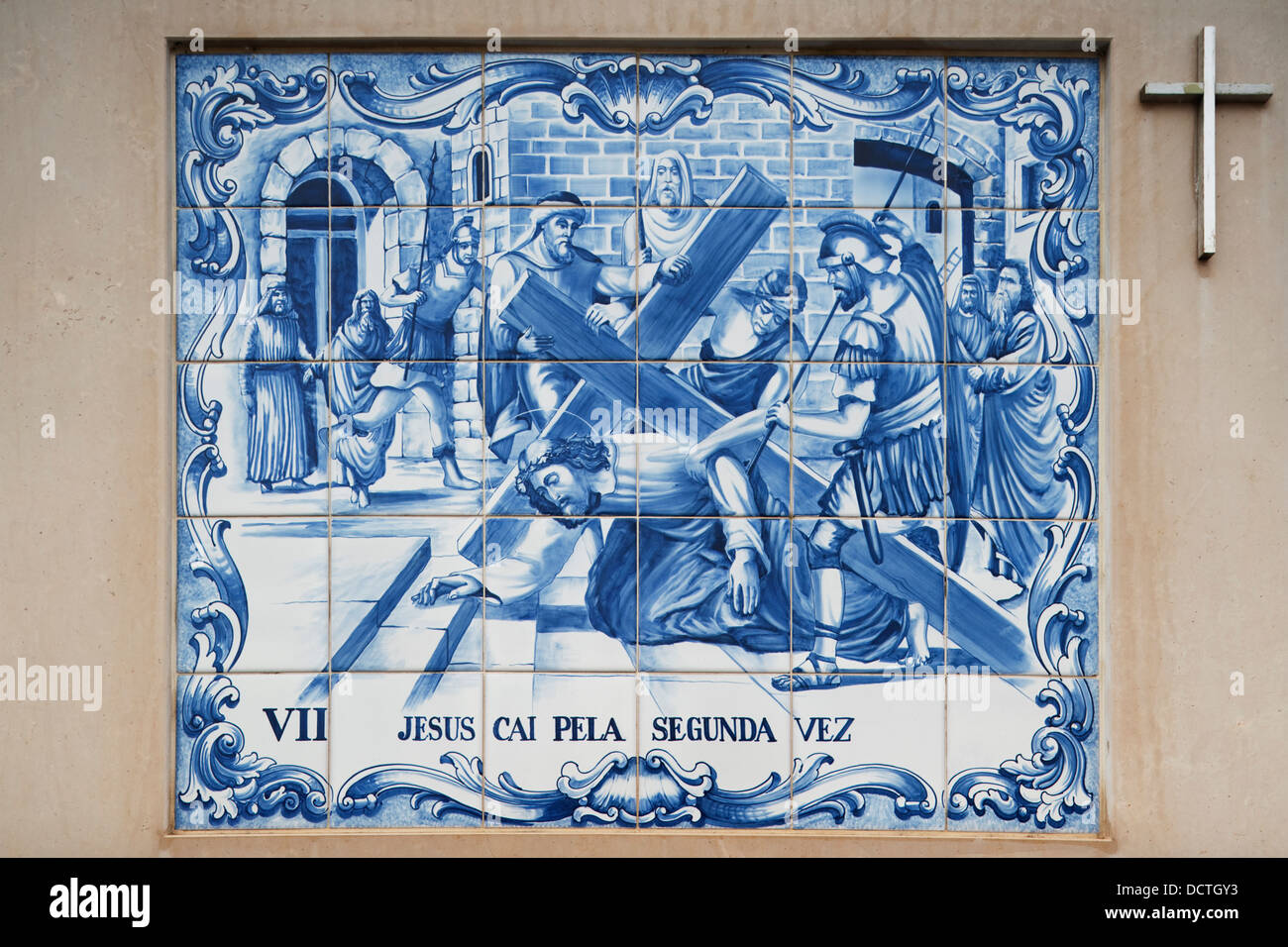 Painted ceramic tile depicting the seventh station of the cross as painted ceramic tile depicting the seventh station of the cross as jesus falls for the second time porto de mos portugal dailygadgetfo Image collections
