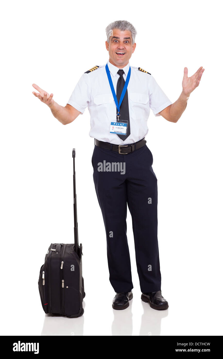 senior airline captain with surprised facial expression on white background - Stock Image
