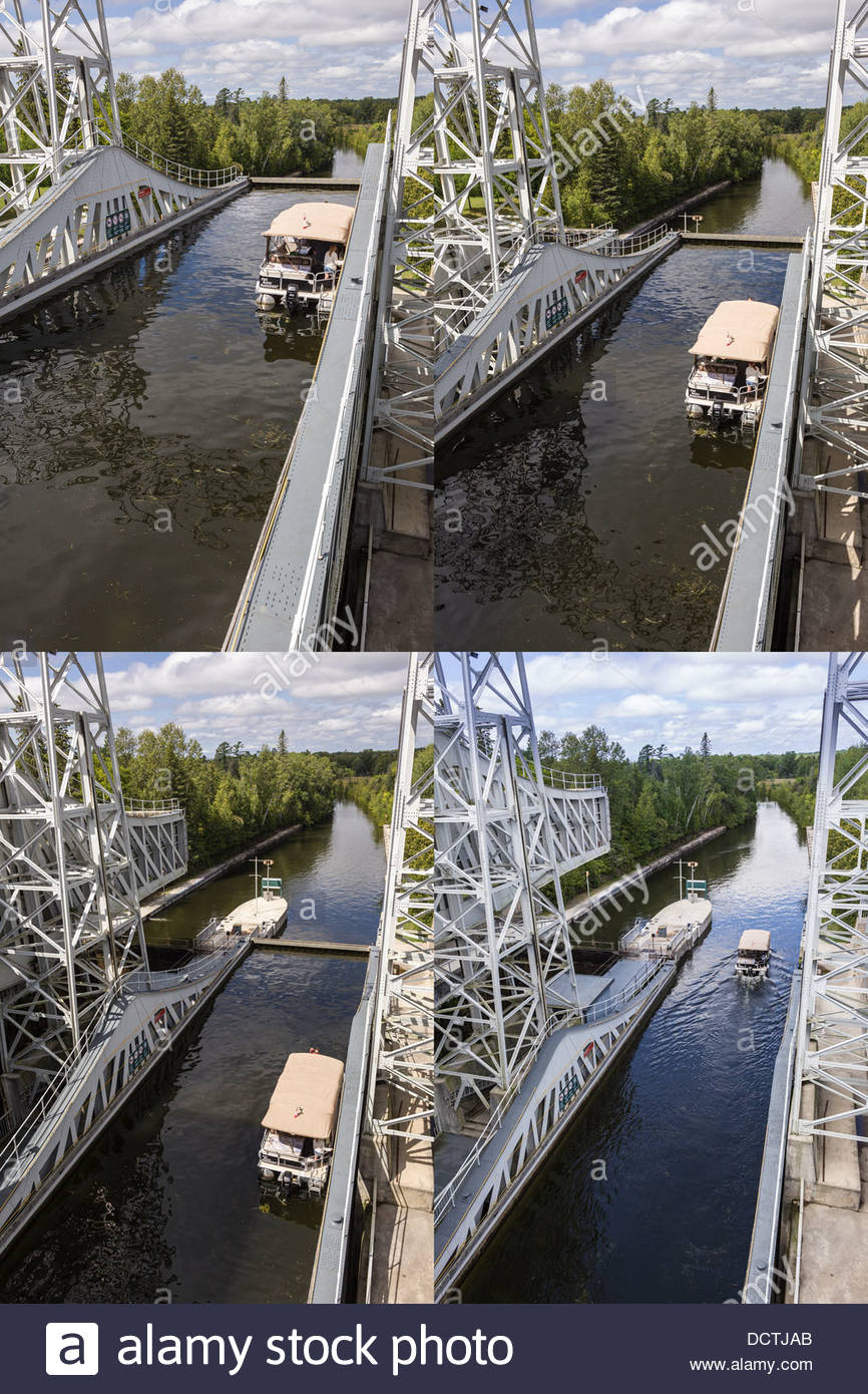 Boat descending to lower reach of Kirkfield Hydraulic Lift Lock on Trent-Severn Waterway at Kirkfield Ontario Canada. - Stock Image