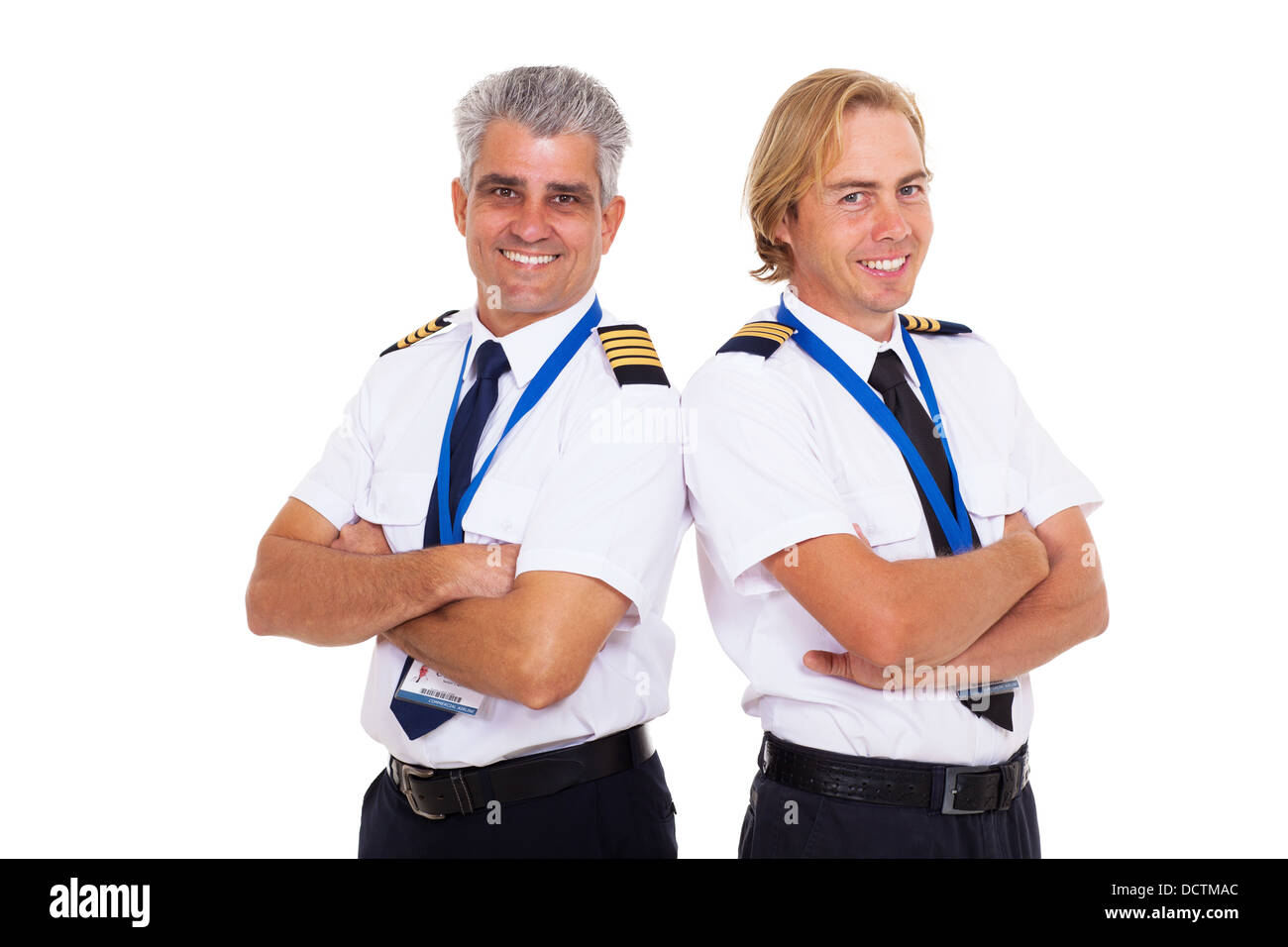 two airline pilots wearing uniform portrait on white background - Stock Image