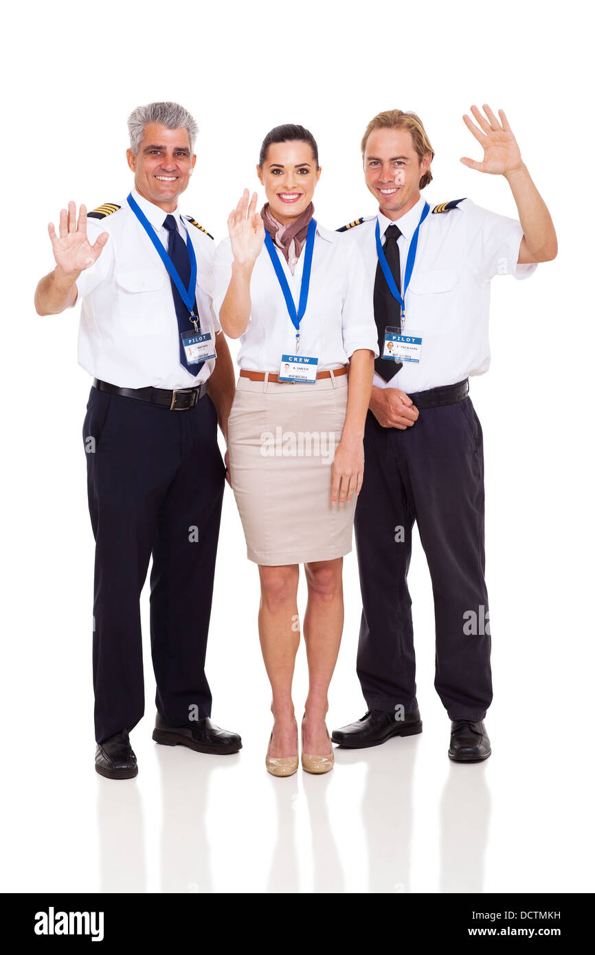 cheerful airline pilots and airhostess waving on white background - Stock Image