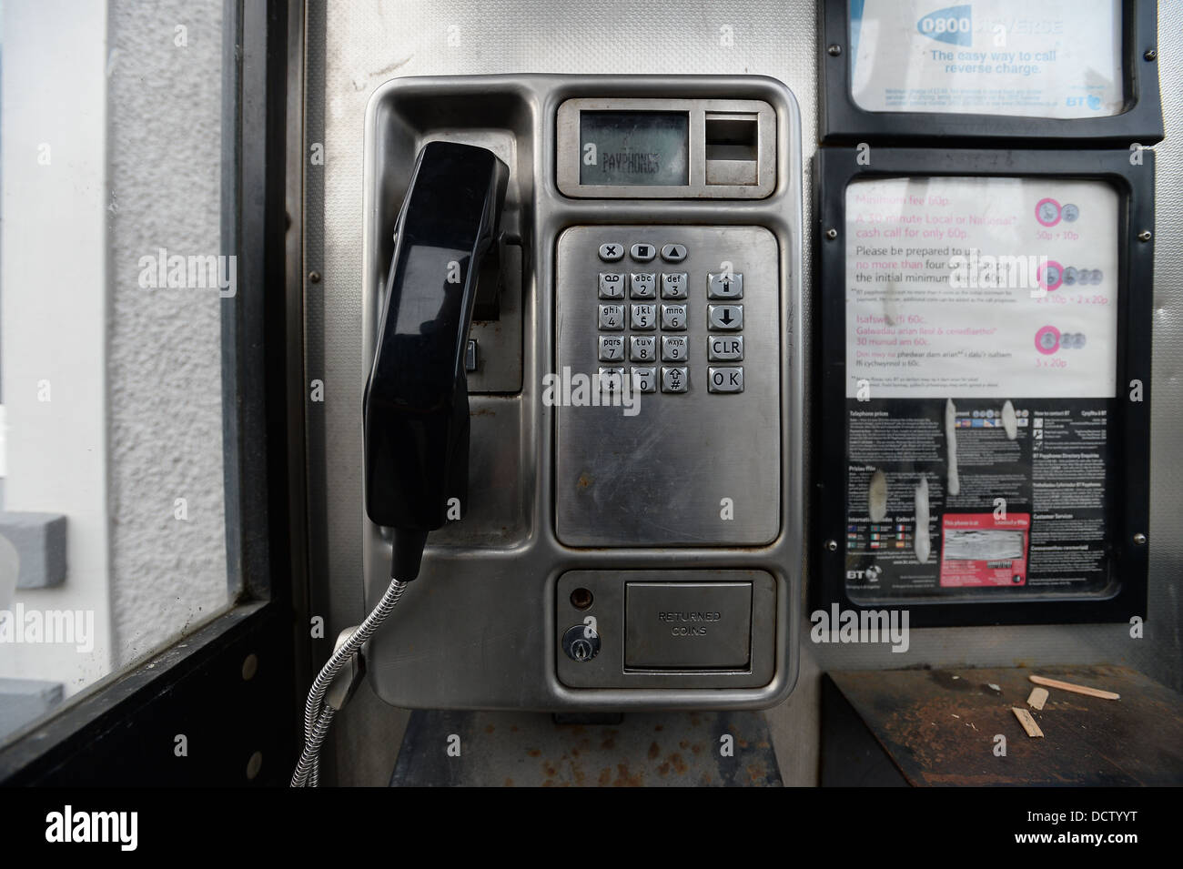 The inside of a British Telecom (BT) telephone box. - Stock Image