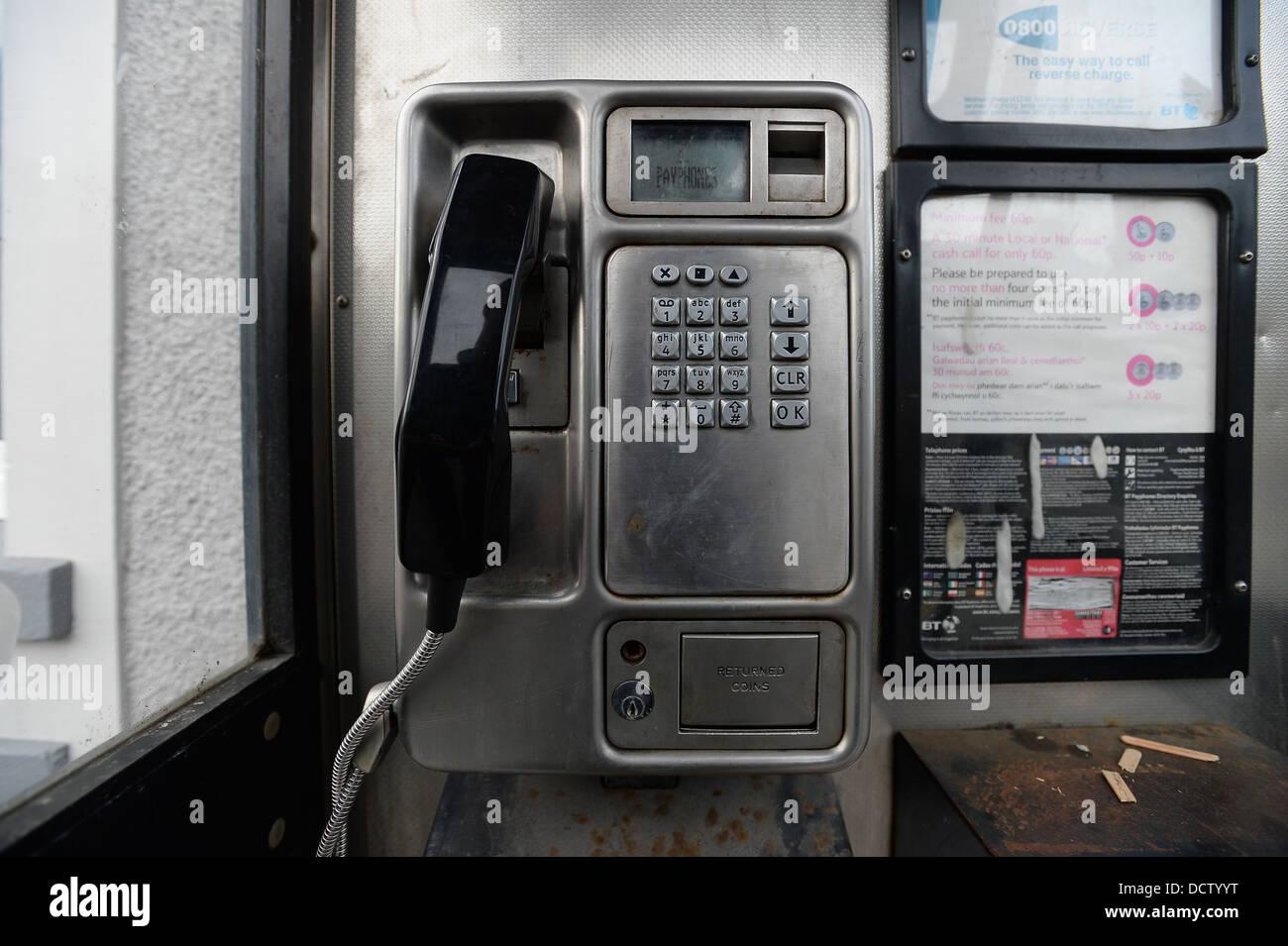The inside of a British Telecom (BT) telephone box. Stock Photo
