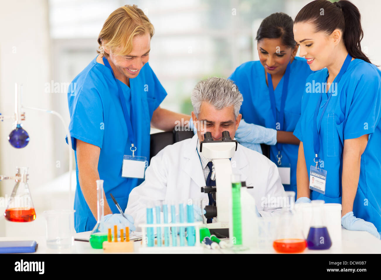 group of scientists working in lab - Stock Image
