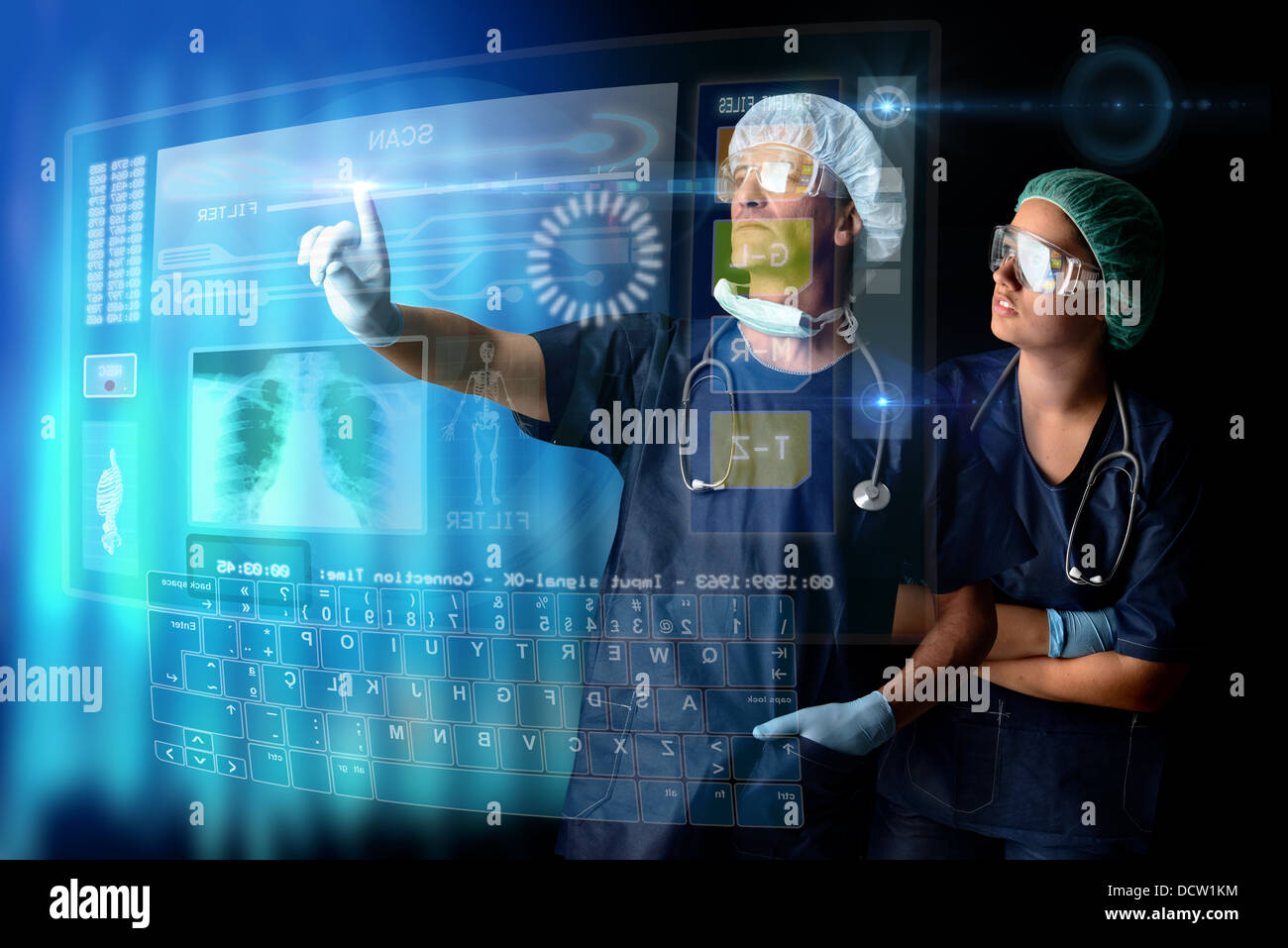 Doctors in a research station with digital screens and keyboard - Stock Image