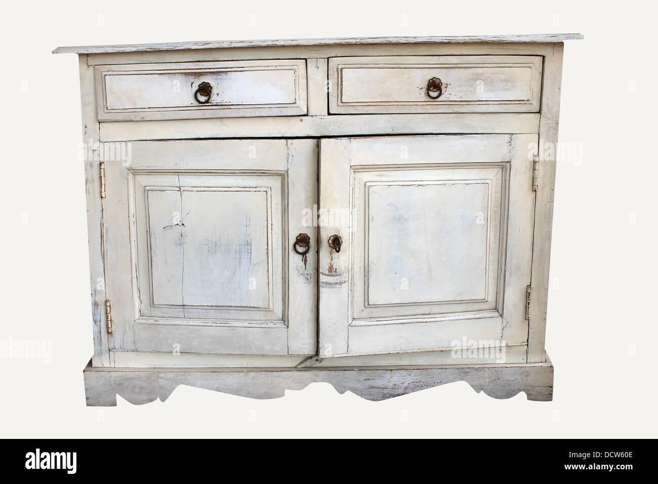 Distressed piece of old furniture isolated on a white background. - Stock Image