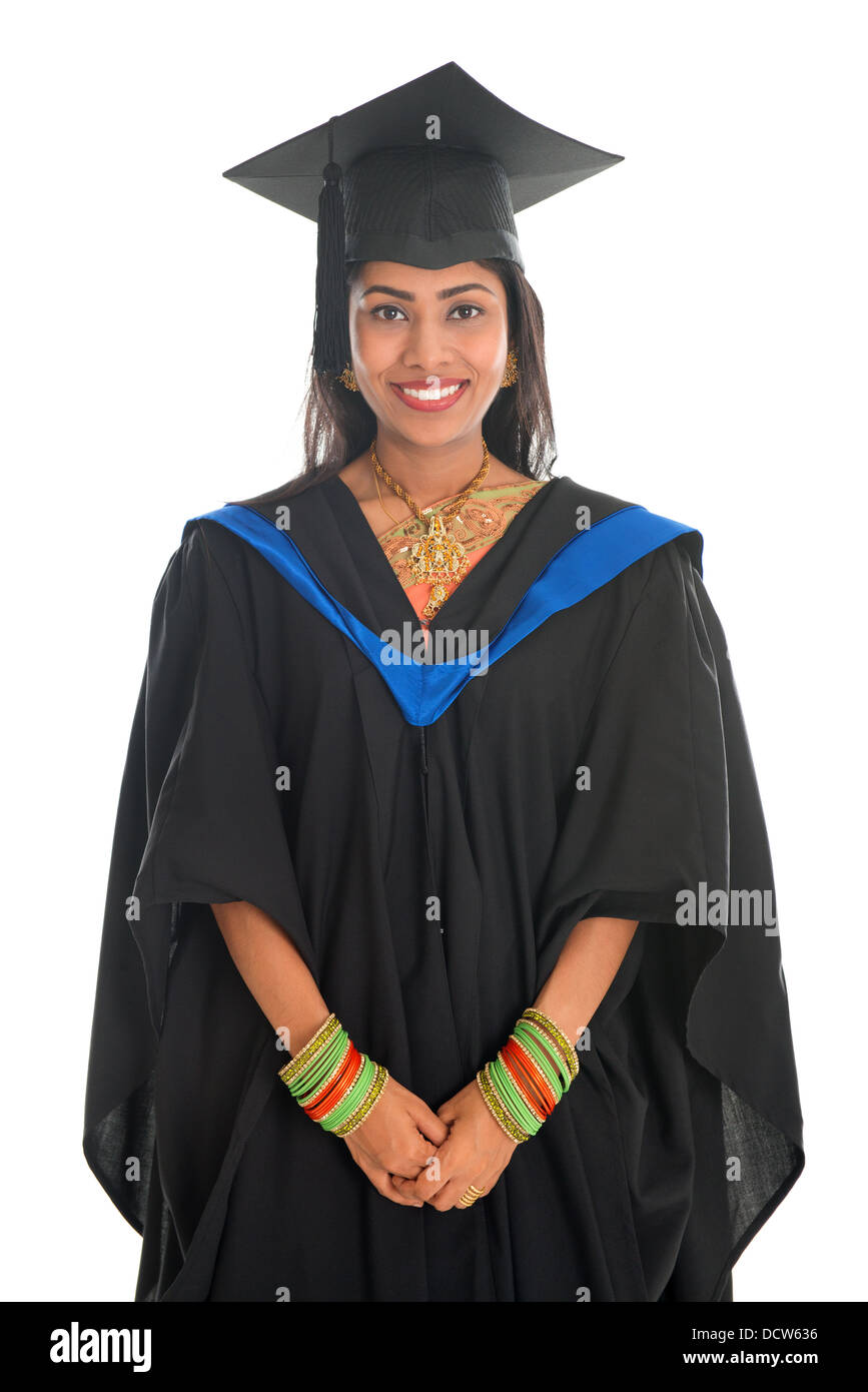 cf938754cf Happy Indian university student in graduation gown and cap. Portrait of  mixed race Asian Indian