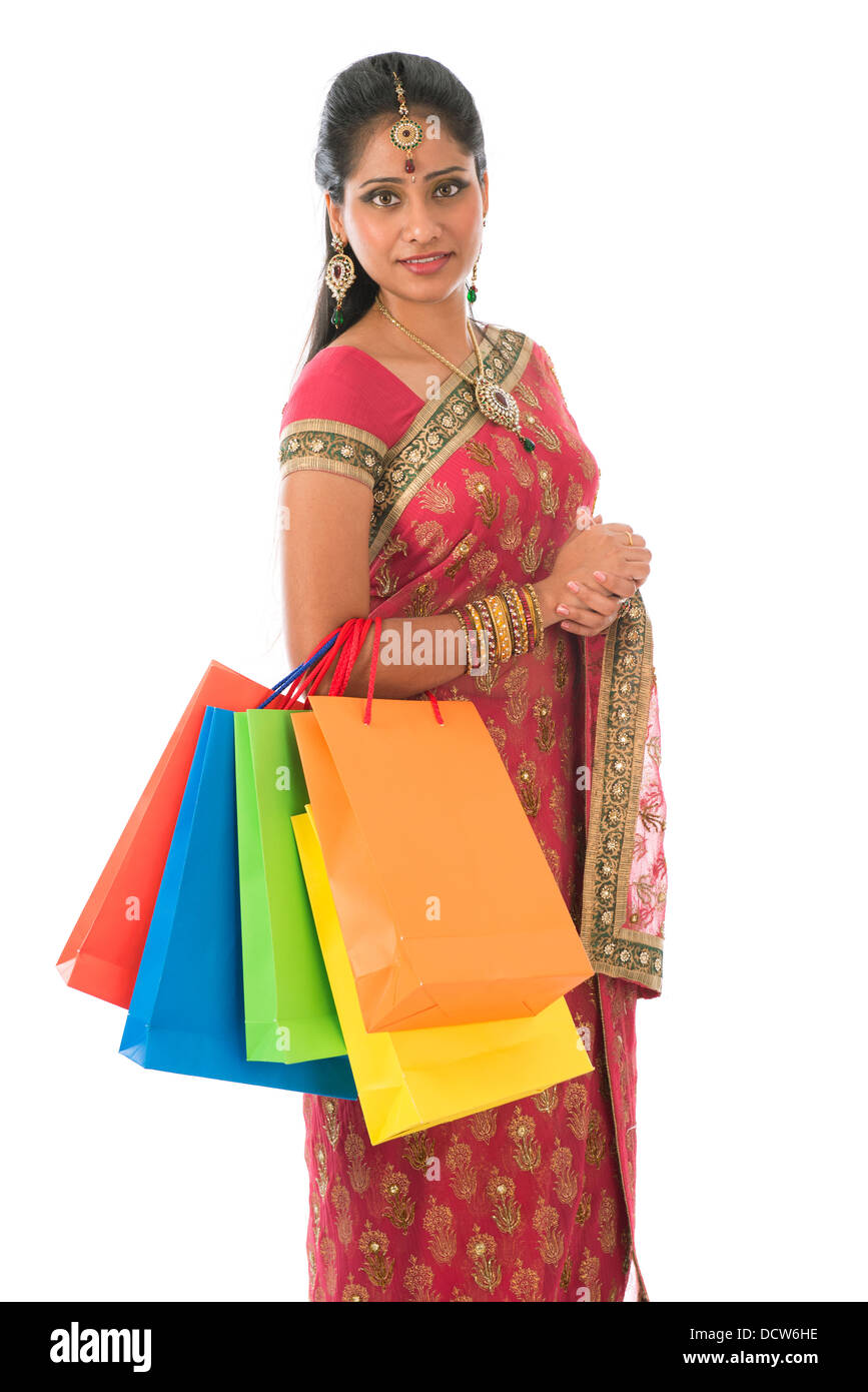 845729691f Beautiful young Indian woman in traditional sari dress having diwali  shopping, standing isolated on white