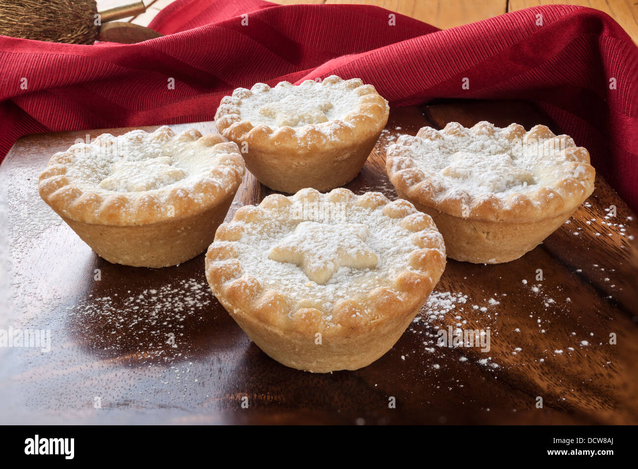 Christmas mince pies with sifted icing sugar - Stock Image