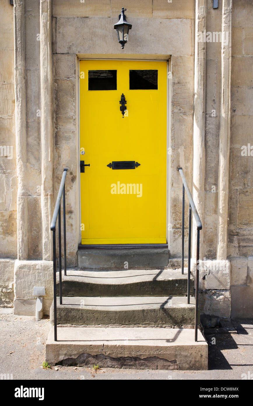 Yellow front Door. Winchcombe, Gloucestershire, England Stock Photo