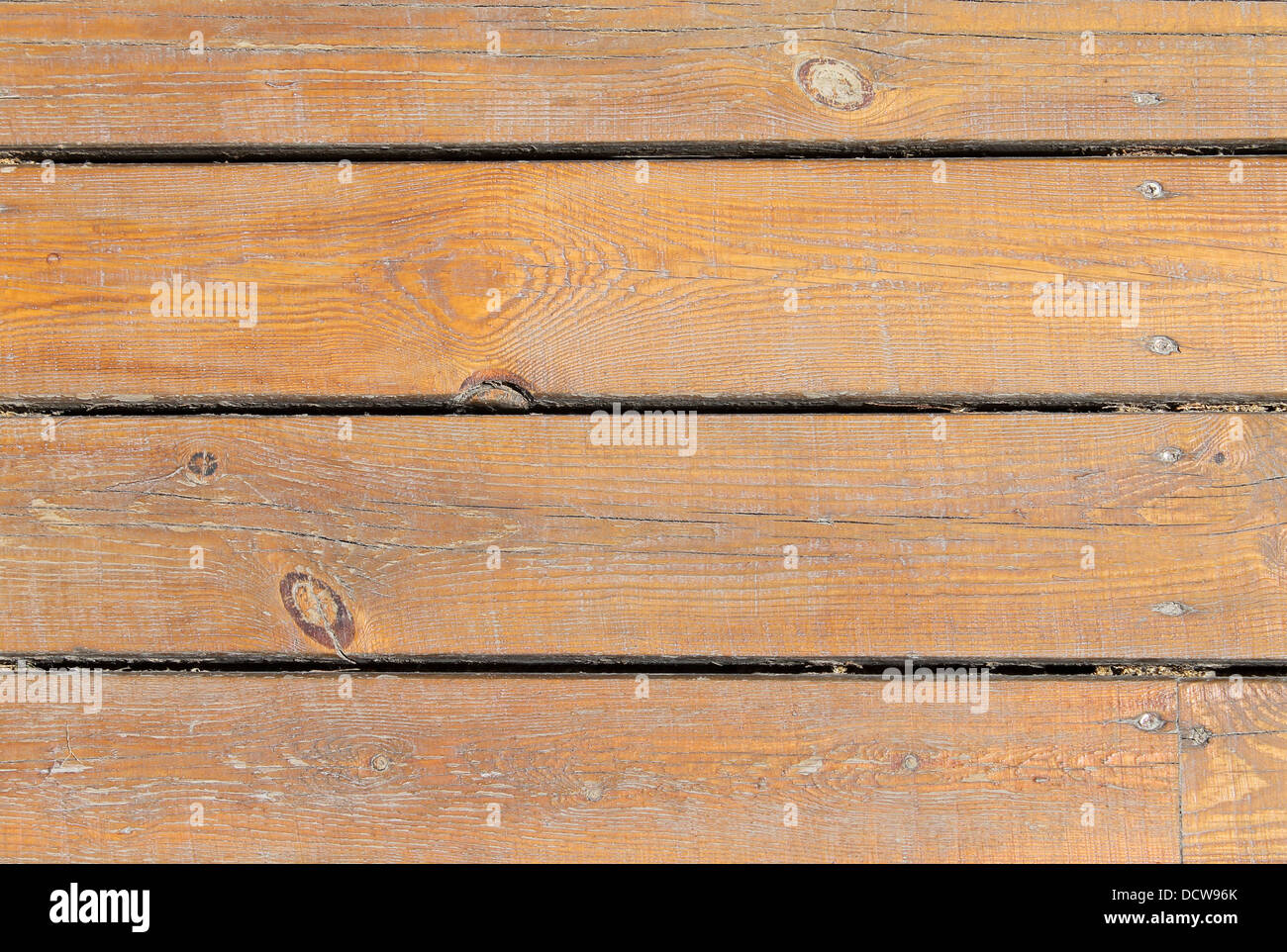 Overhead view of textured brown wooden background. - Stock Image