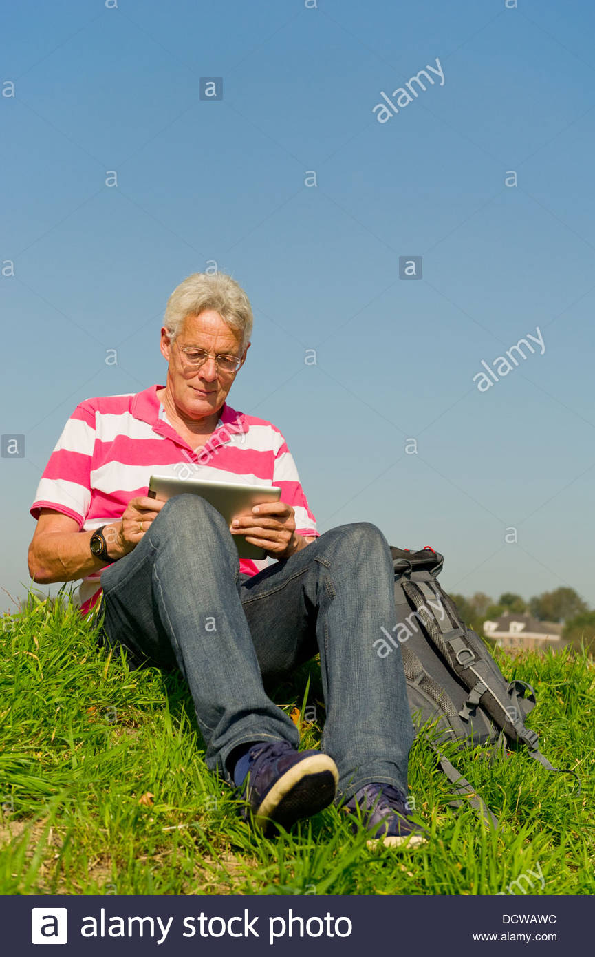 Senior with tablet PC outdoor Stock Photo