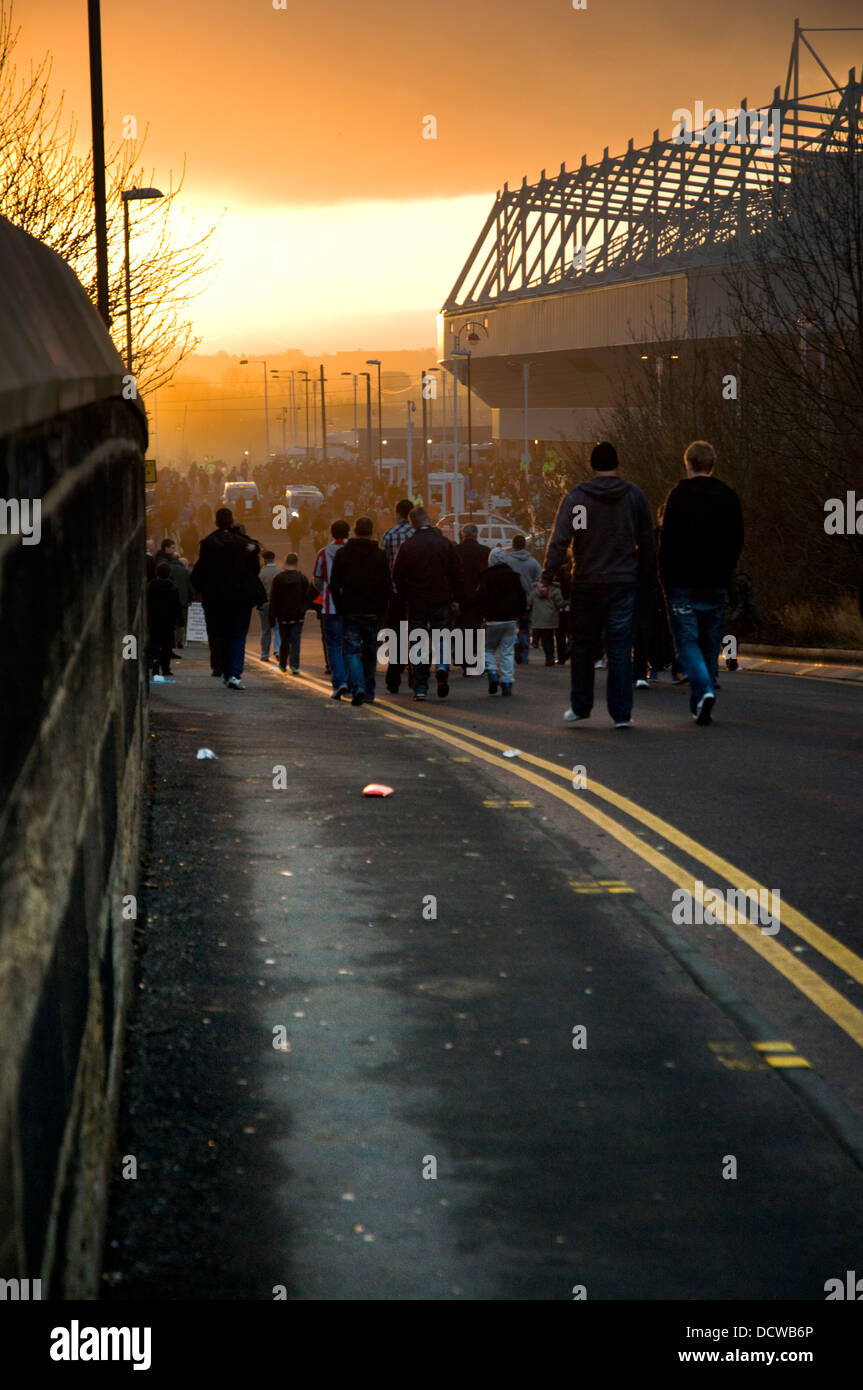 Sunderland AFC supporters walk to an evening kick off in the Premier League at the Stadium of Lighy - Stock Image
