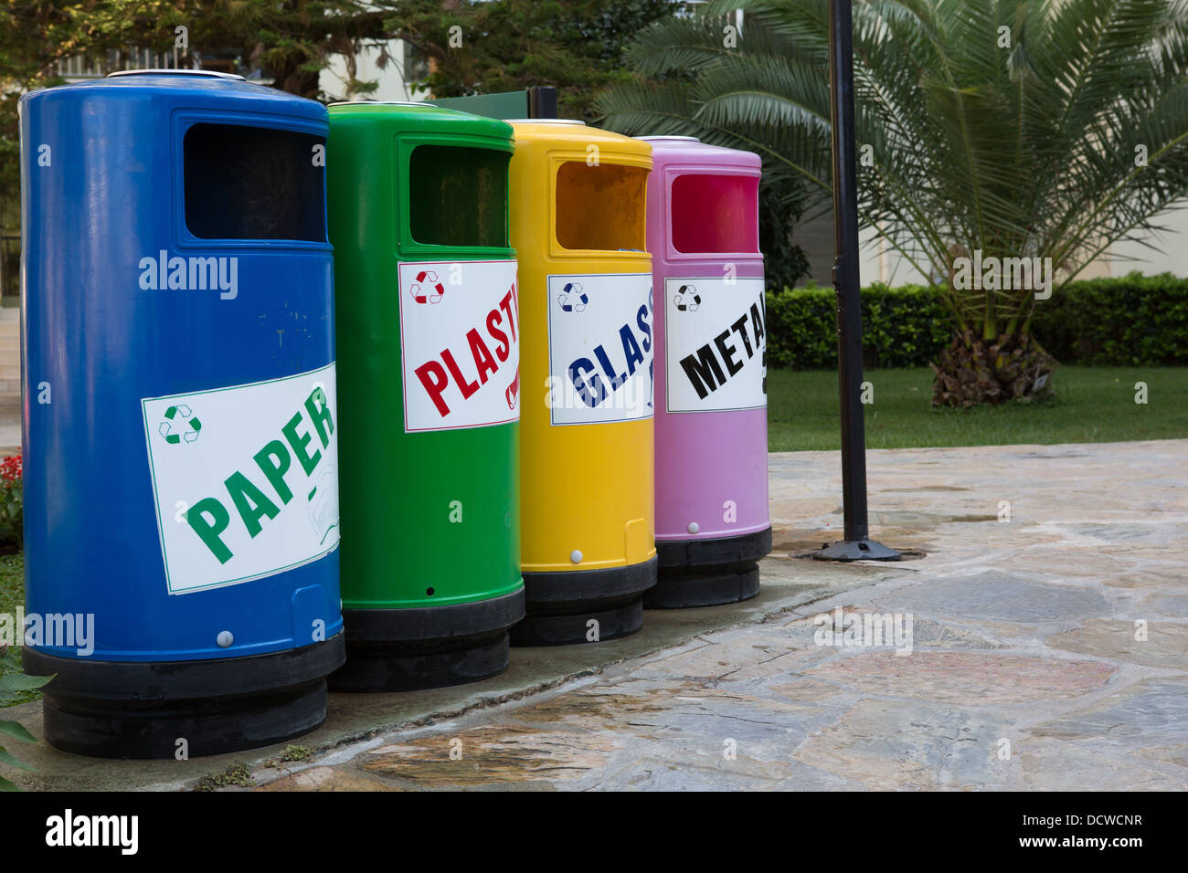 Colourful recycling bins Stock Photo