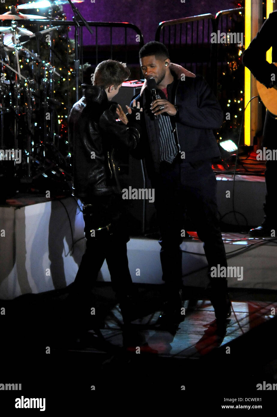 Justin Bieber and Usher performing during the taping of the ...
