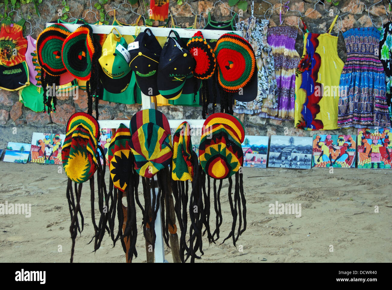 Novelty rasta hats and caps for sale on the beach, Ocho Rios, Middlesex County, Jamaica, Caribbean. - Stock Image