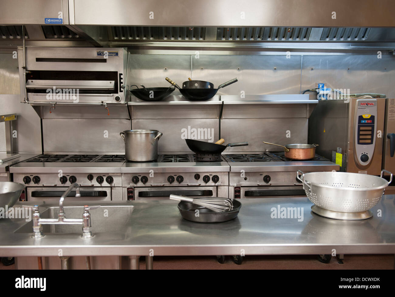Chef's kitchen with pots and pans - Stock Image