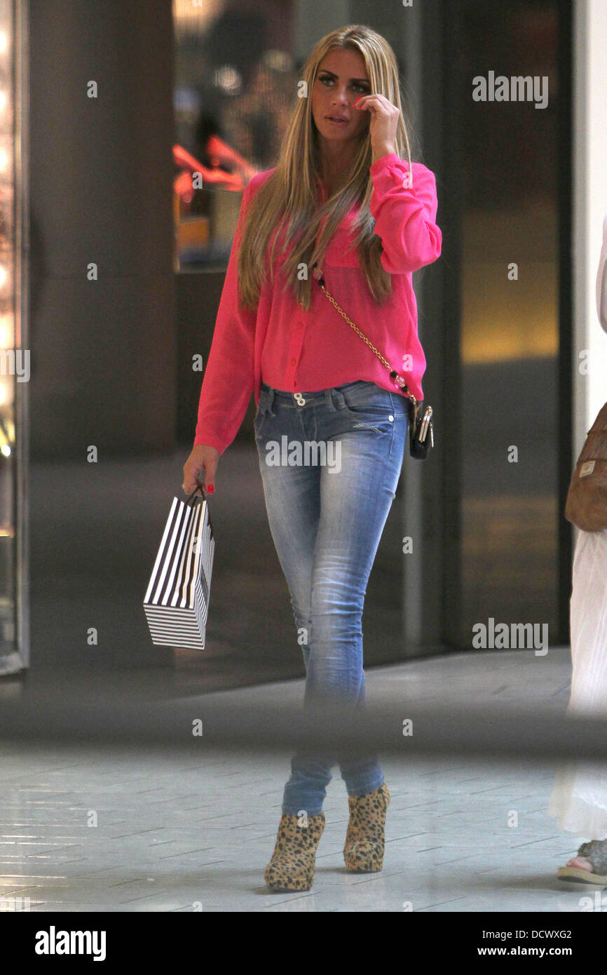 bf2f1f39057d Katie Price wearing skinny jeans and leopard print boots, shopping at the  Beverly Center in