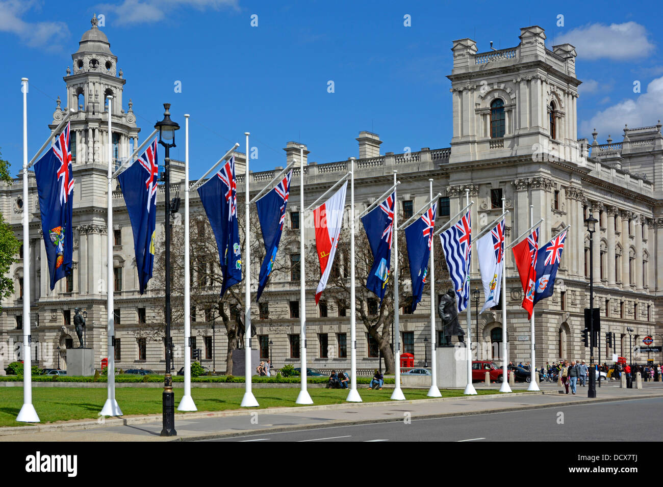 Flags in Parliament Square with Government Offices beyond - Stock Image