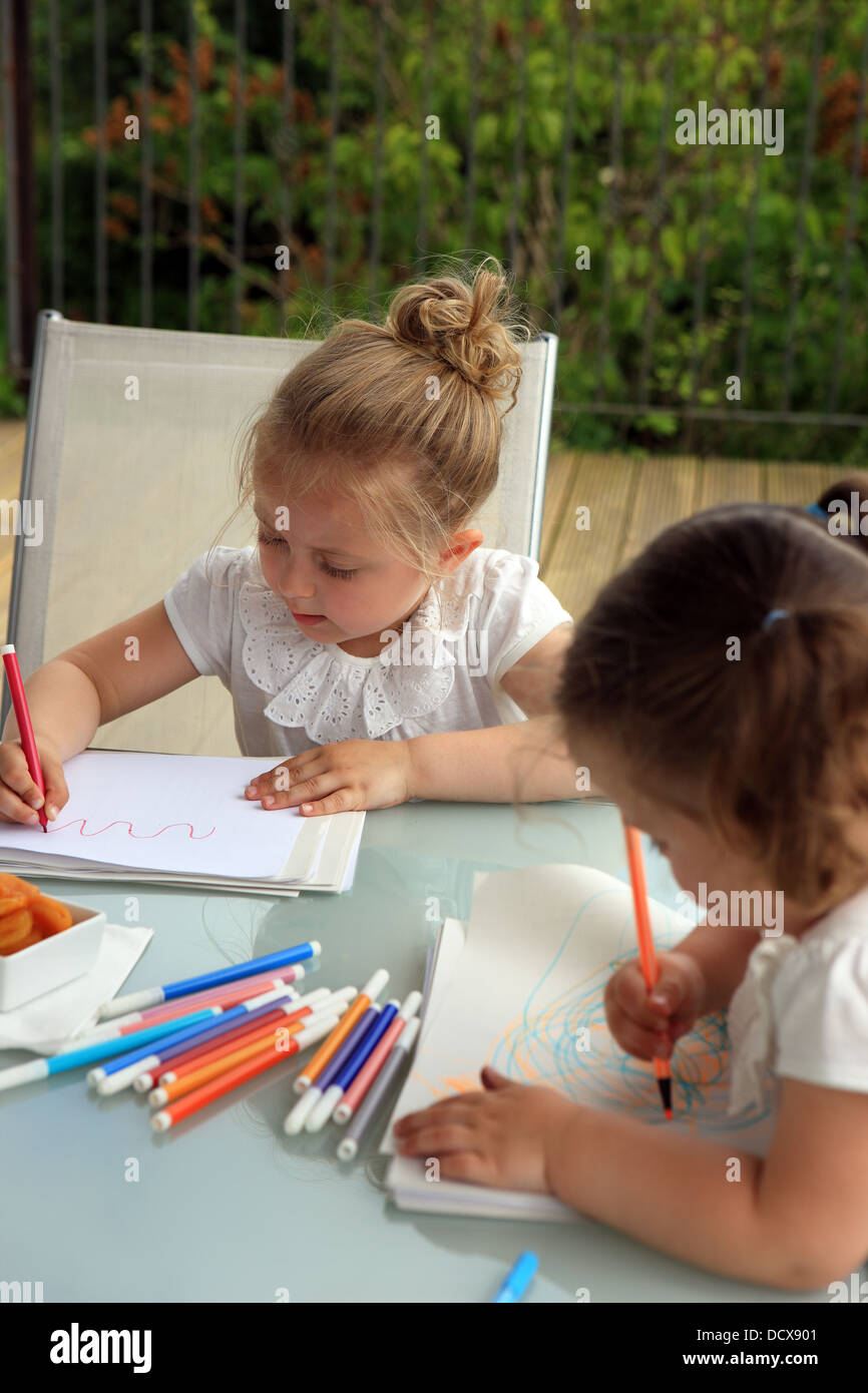 Children's drawings highlighting the marked difference in artistic impression and pen control between 2 and - Stock Image