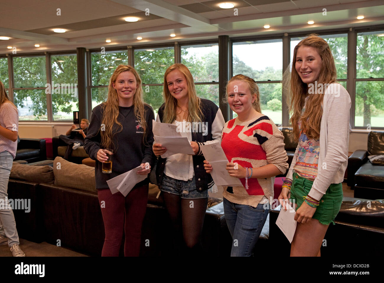 Bromley.UK,22ndAugust 2013, GCSE students celebrate their results from Bromley hIgh Schoo Credit: Keith Larby/Alamy - Stock Image