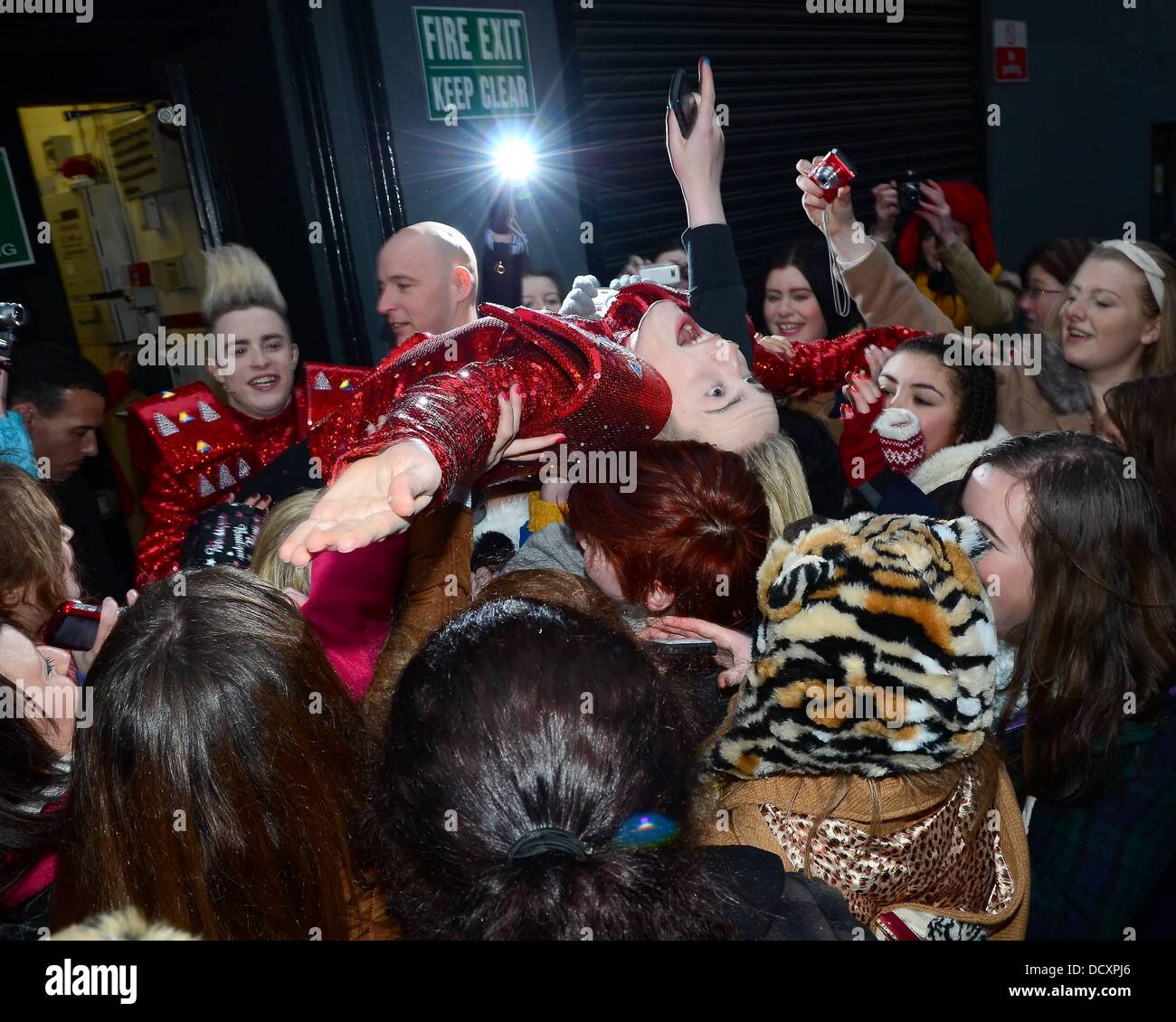 Jedward invent a new craze of crowd surfing on the hundreds teenage girls that wait for them outside the Stage Door - Stock Image