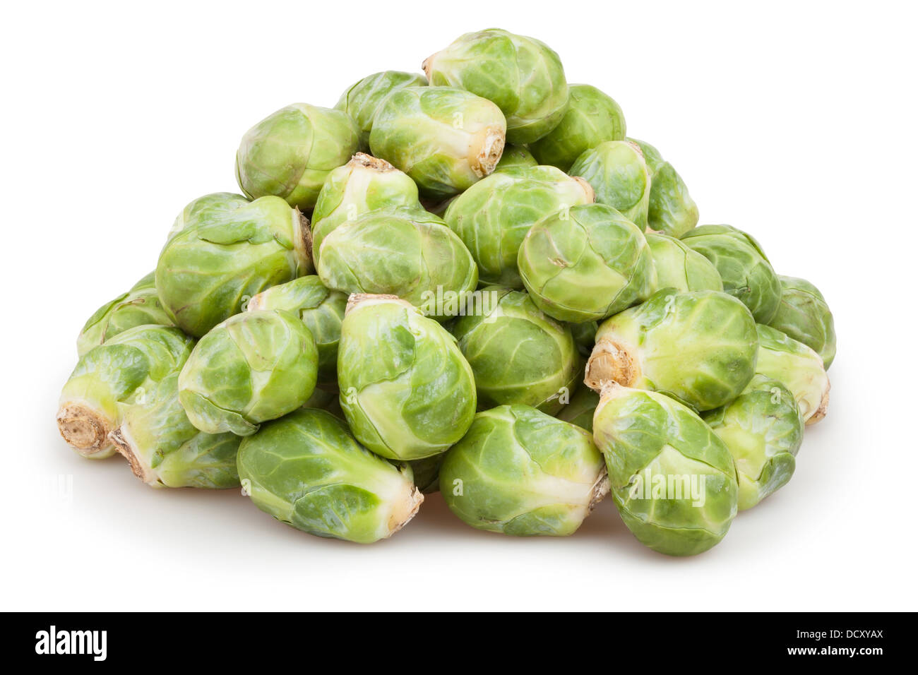brussels sprouts heap on white background - Stock Image