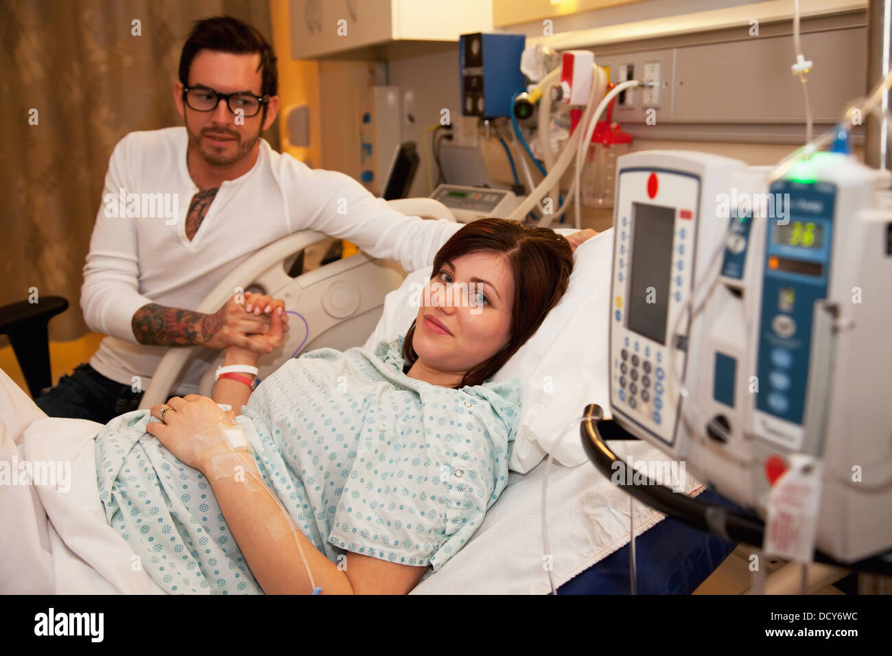 Couple Expecting Baby In Maternity Ward - Stock Image