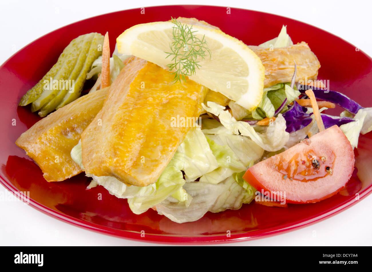 Fresh Scottish kipper with organic salad on a plate - Stock Image