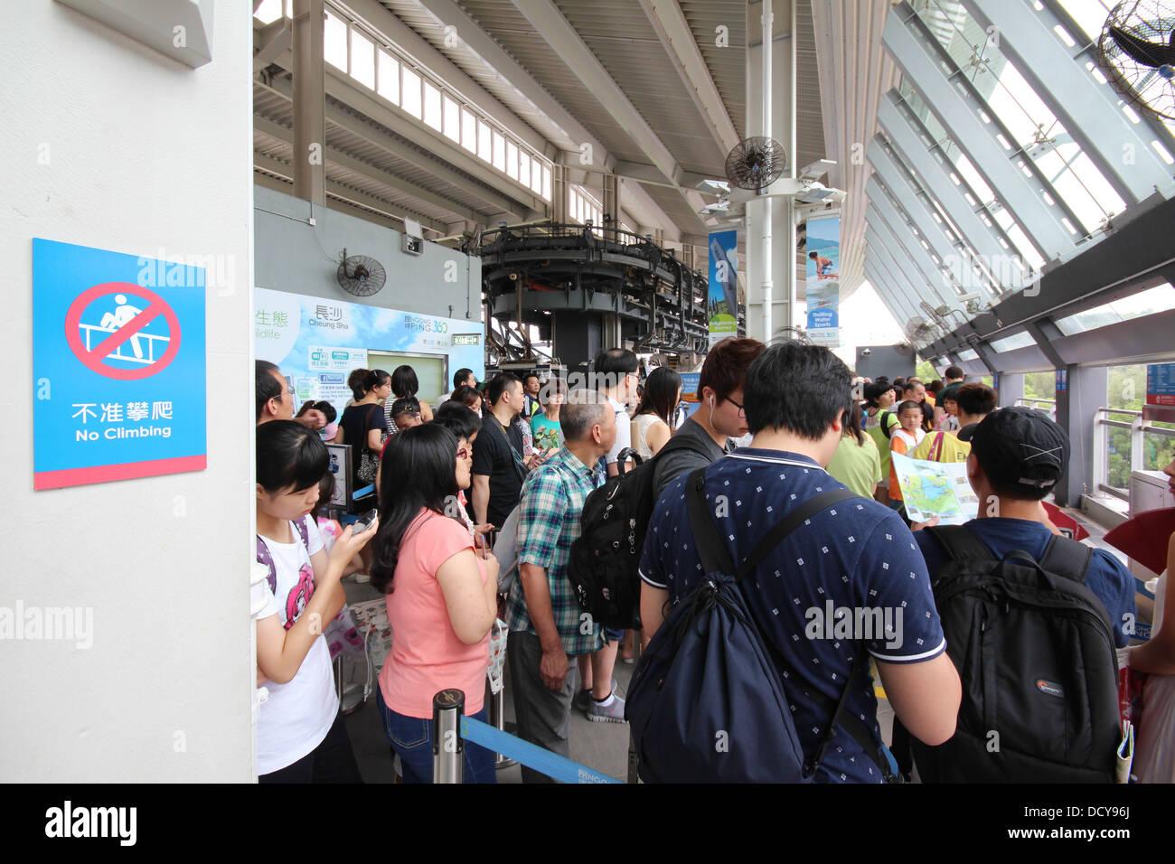 Queue for the cable car at Ngong Ping 360, Lantau Island, Hong Kong, China - Stock Image