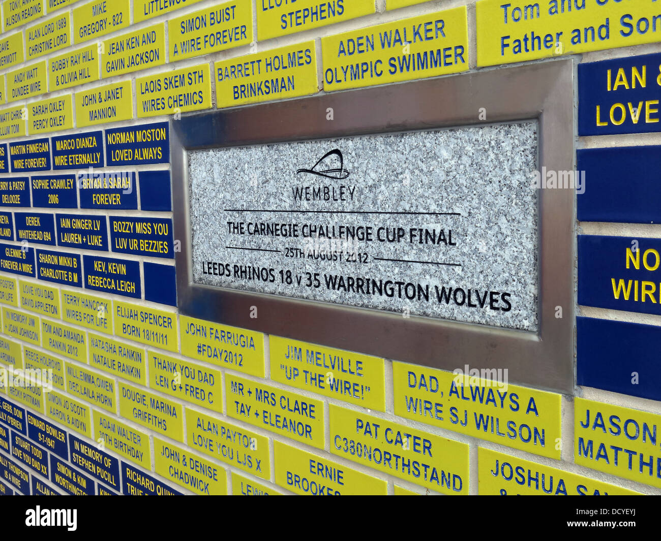 Carnegie Challenge Cup memorial plaque at Halliwell Jones stadium, Mike Gregory Way / Winwick Rd, Warrington, WA2 - Stock Image