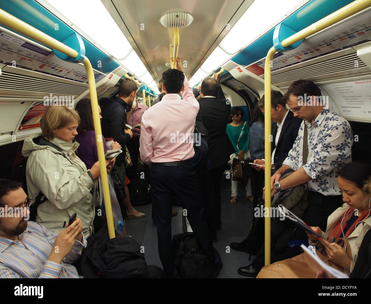 London underground, crowded with commuters - Stock Image