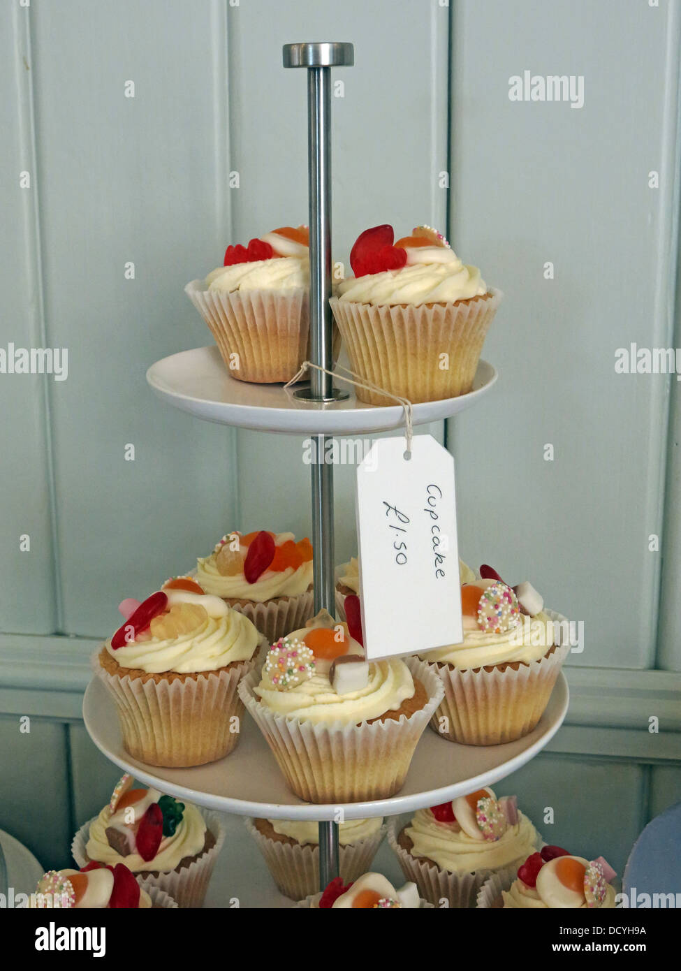 Some classic cupcakes on a stand , for sale £1.50 each - Stock Image