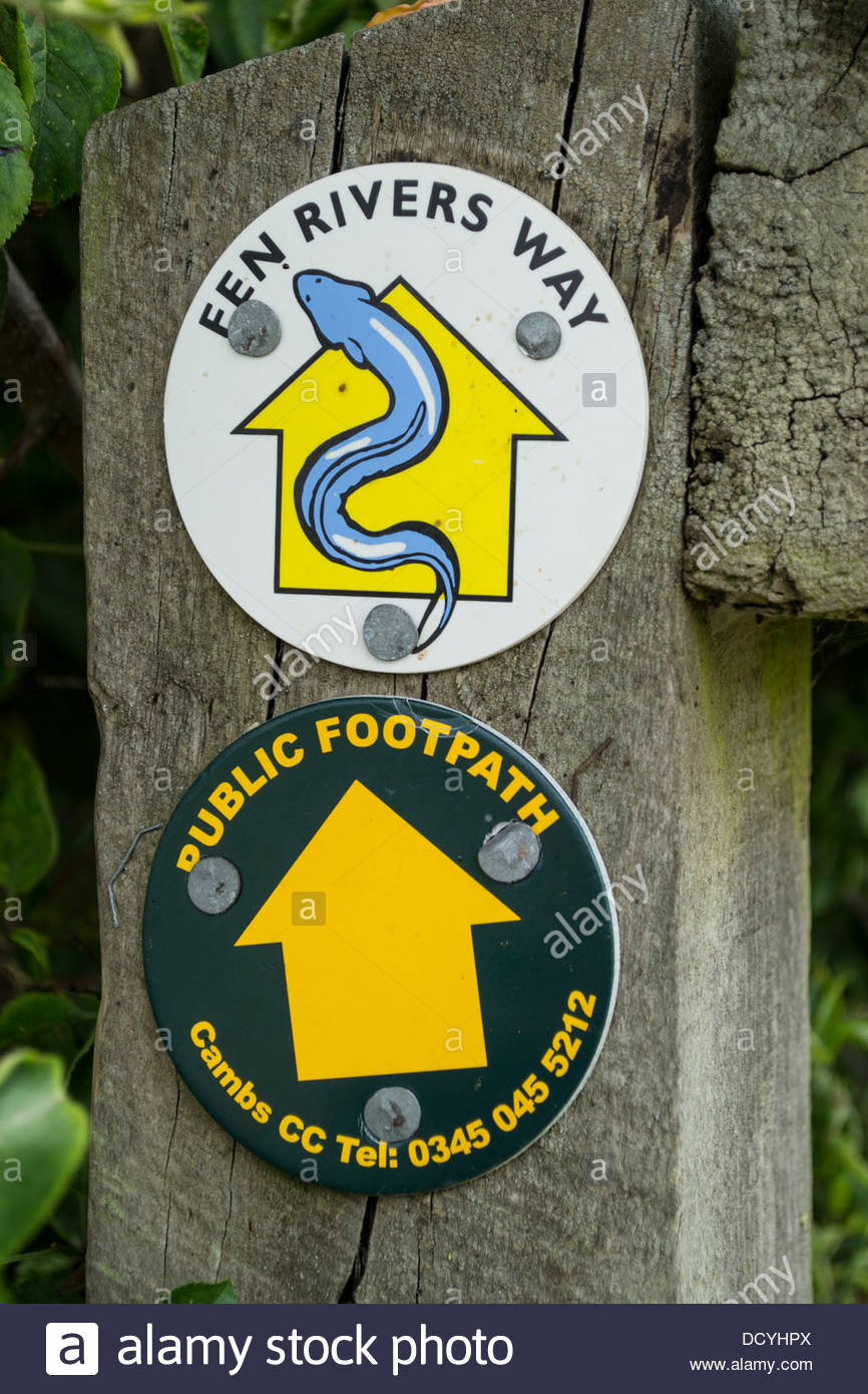 Public footpath and Fen Rivers Way signs on a wooden post in Cambridgeshire - Stock Image