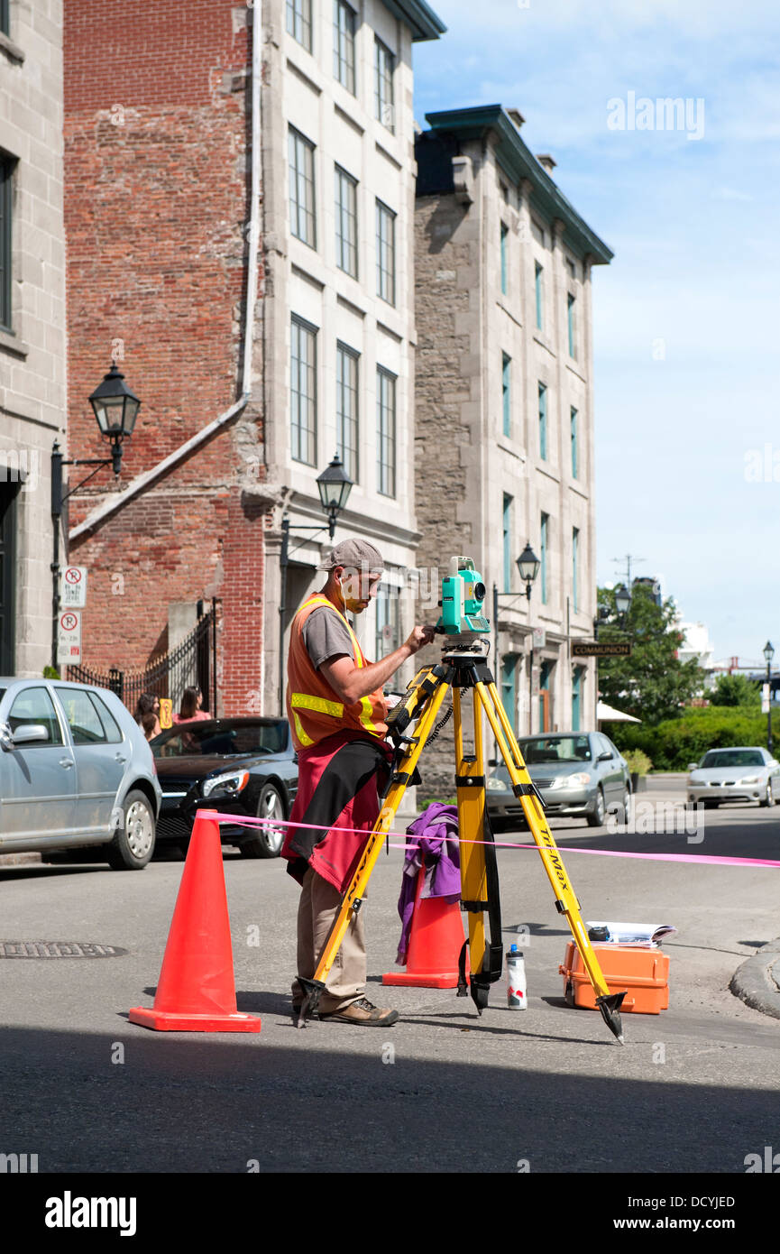 Land surveyor at work in Old Montreal, Canada. - Stock Image