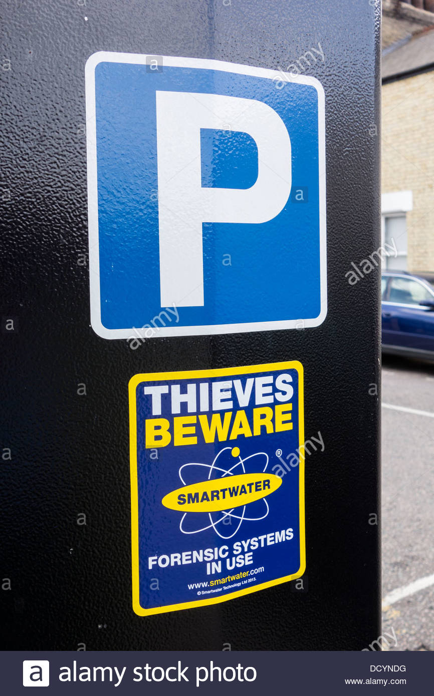 Parking meter in Cambridge with Smartwater forensic system label, warning thieves to beware. - Stock Image