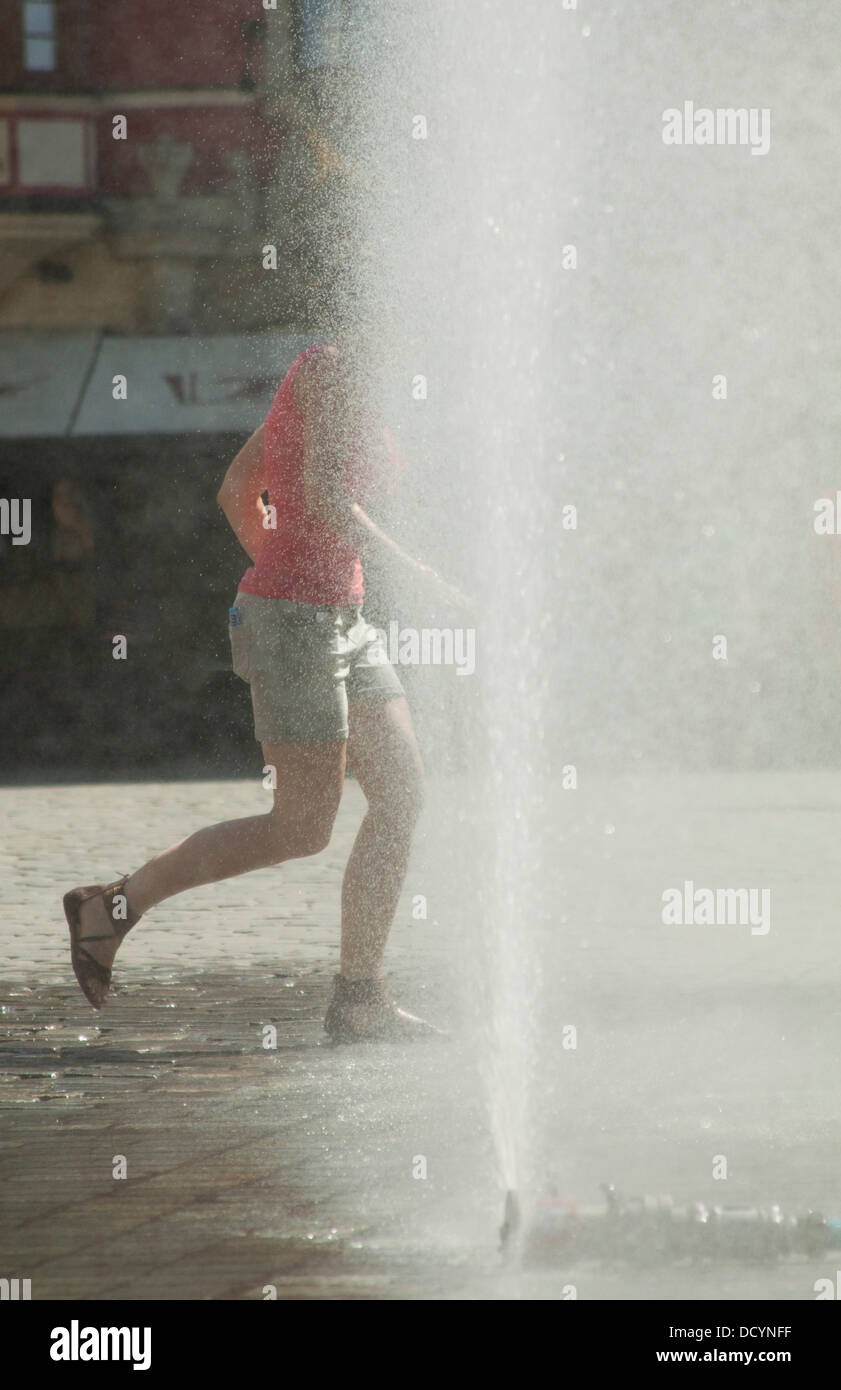 Water spray in city center during hot summer day - Stock Image