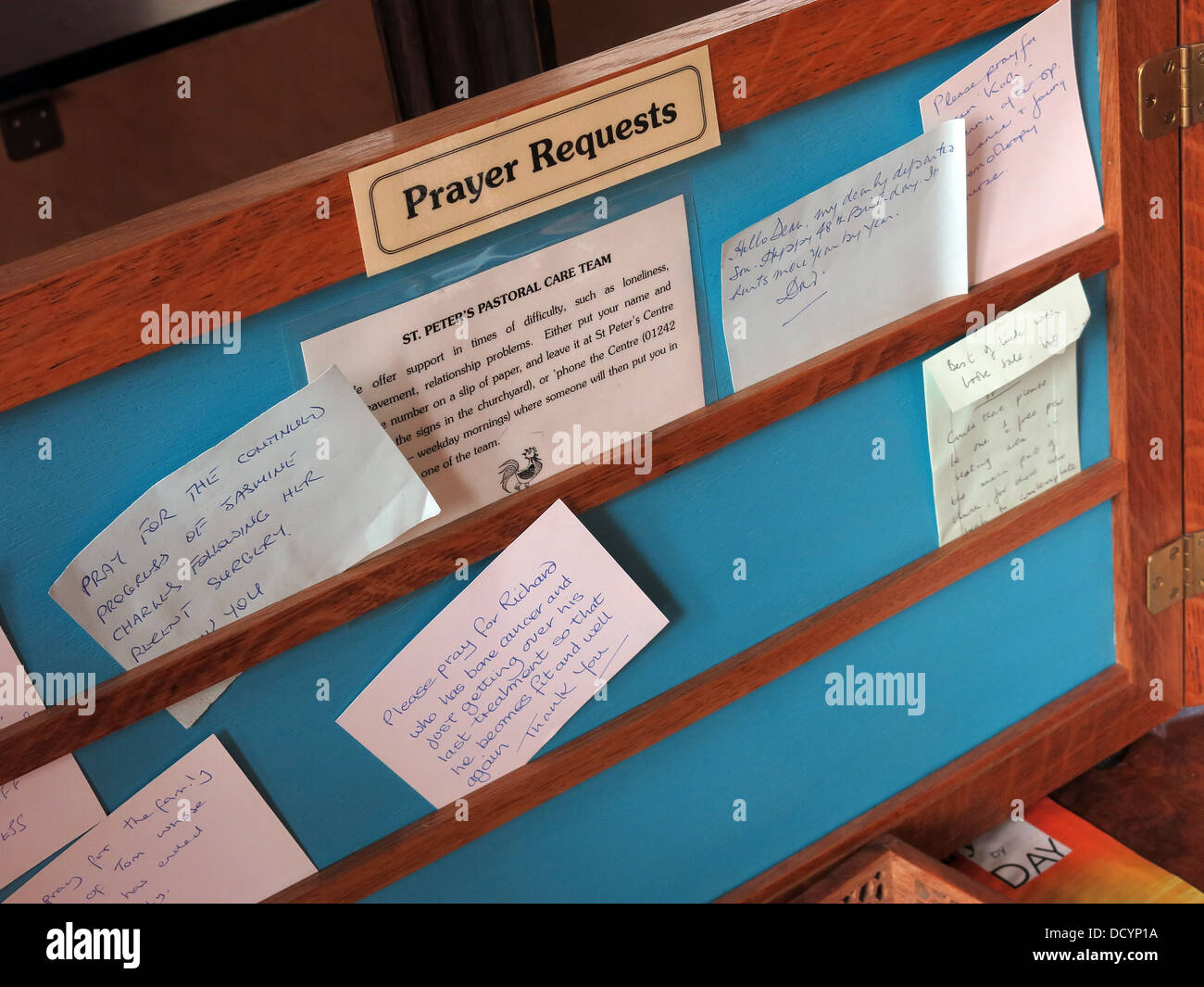 A prayer request board with notes, in a church entrance Winchcombe Cotswolds England UK - Stock Image