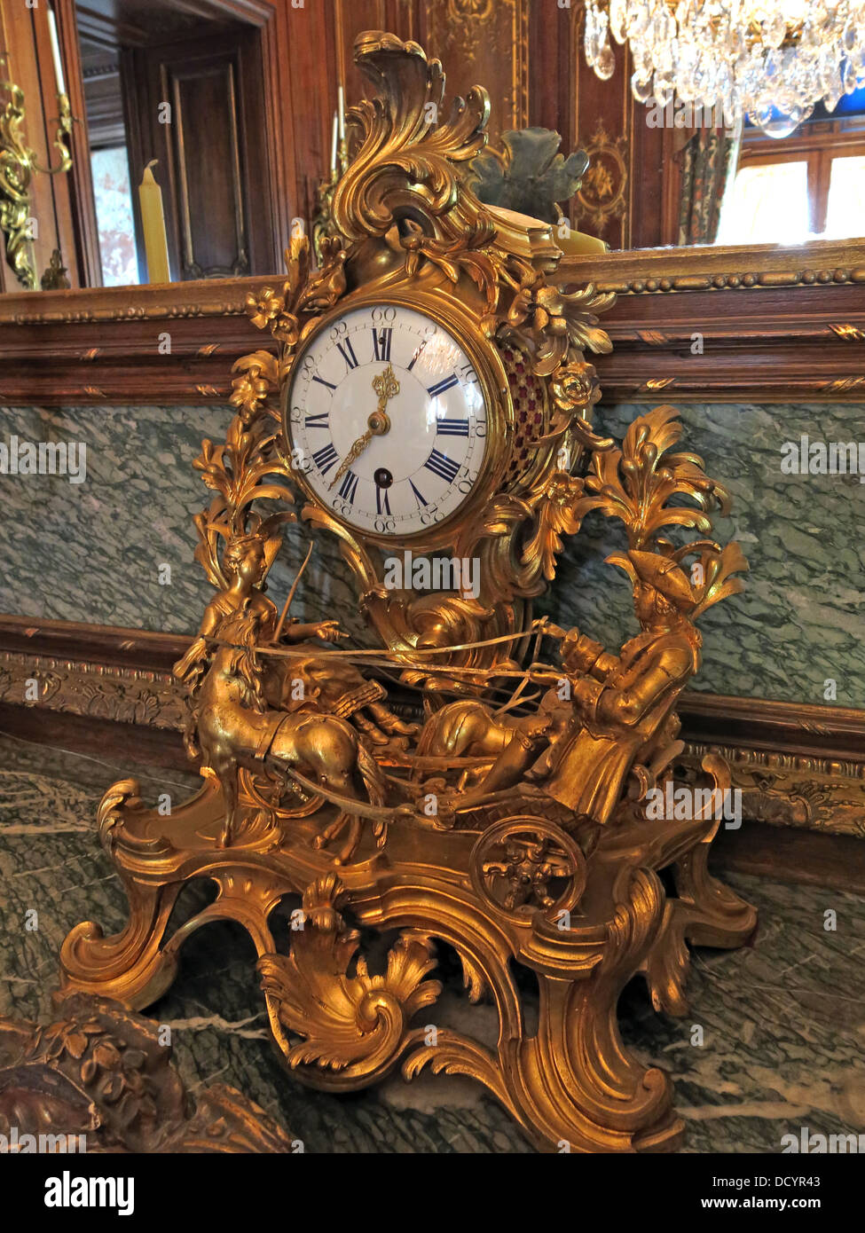 Gold mantlepiece clock at Waddesdon Manor , National Trust England UK - Stock Image