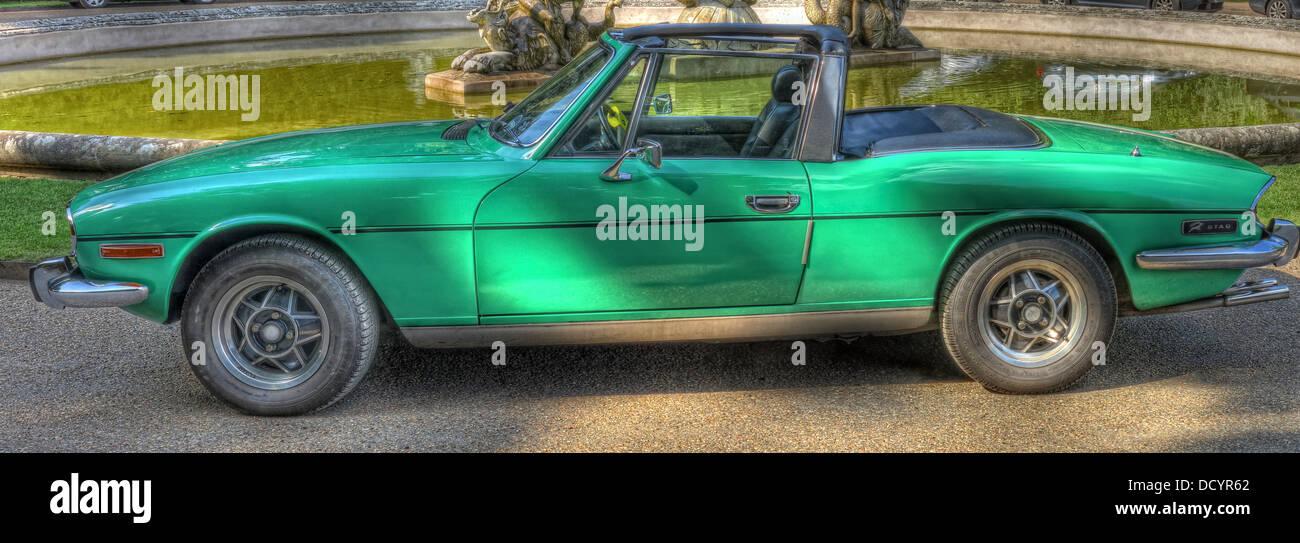 Green Triumph Stag, 2+2 sports tourer, British Triumph Motor Company, styled by Italian designer Giovanni Michelotti - Stock Image