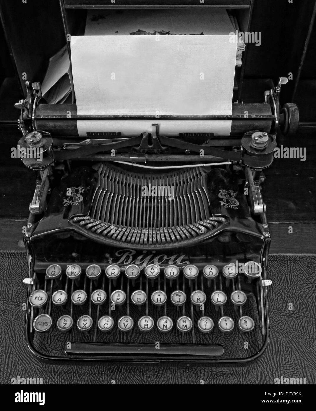 An old fashioned typewriter with a blank sheet of paper for a new message - Stock Image